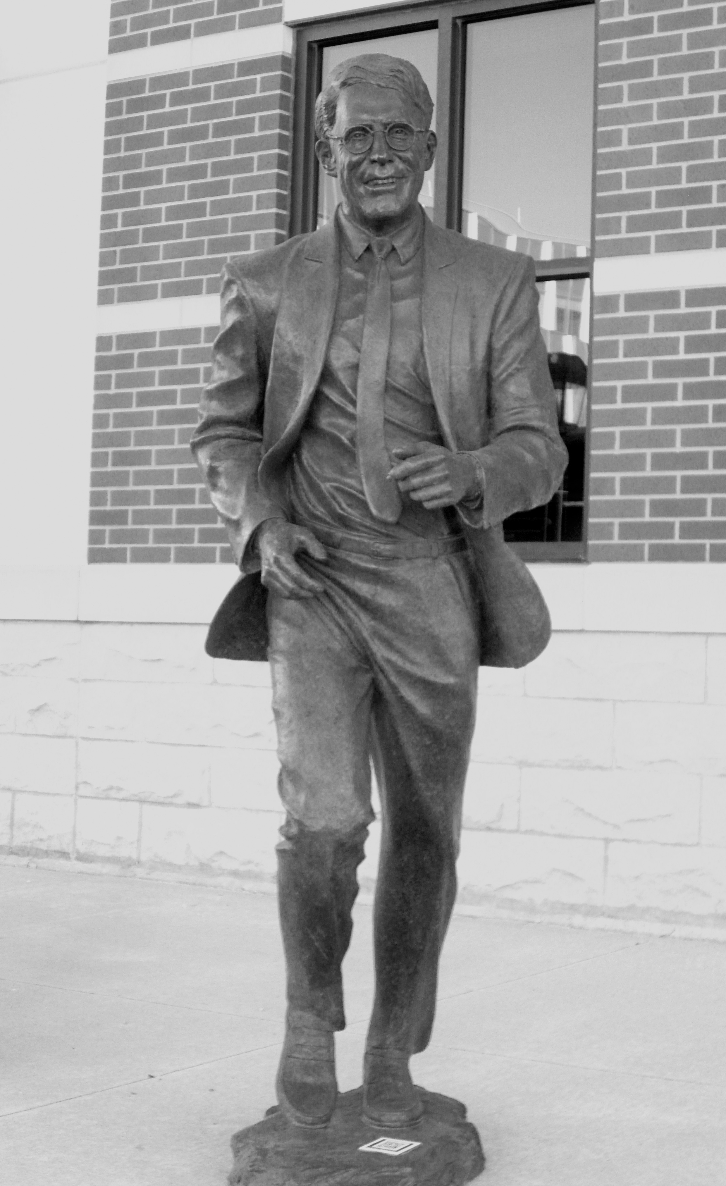 The Frank Farrar bronze in place, on Sioux Avenue, on the North side of First National Bank in Pierre. Not really  my favorite placement for the piece.  If you're not used to it, it can be a little disconcerting driving up the street and seeing a guy about to dash in front of you. Someone once did hang a $$$ sack from his hand just for fun, though.