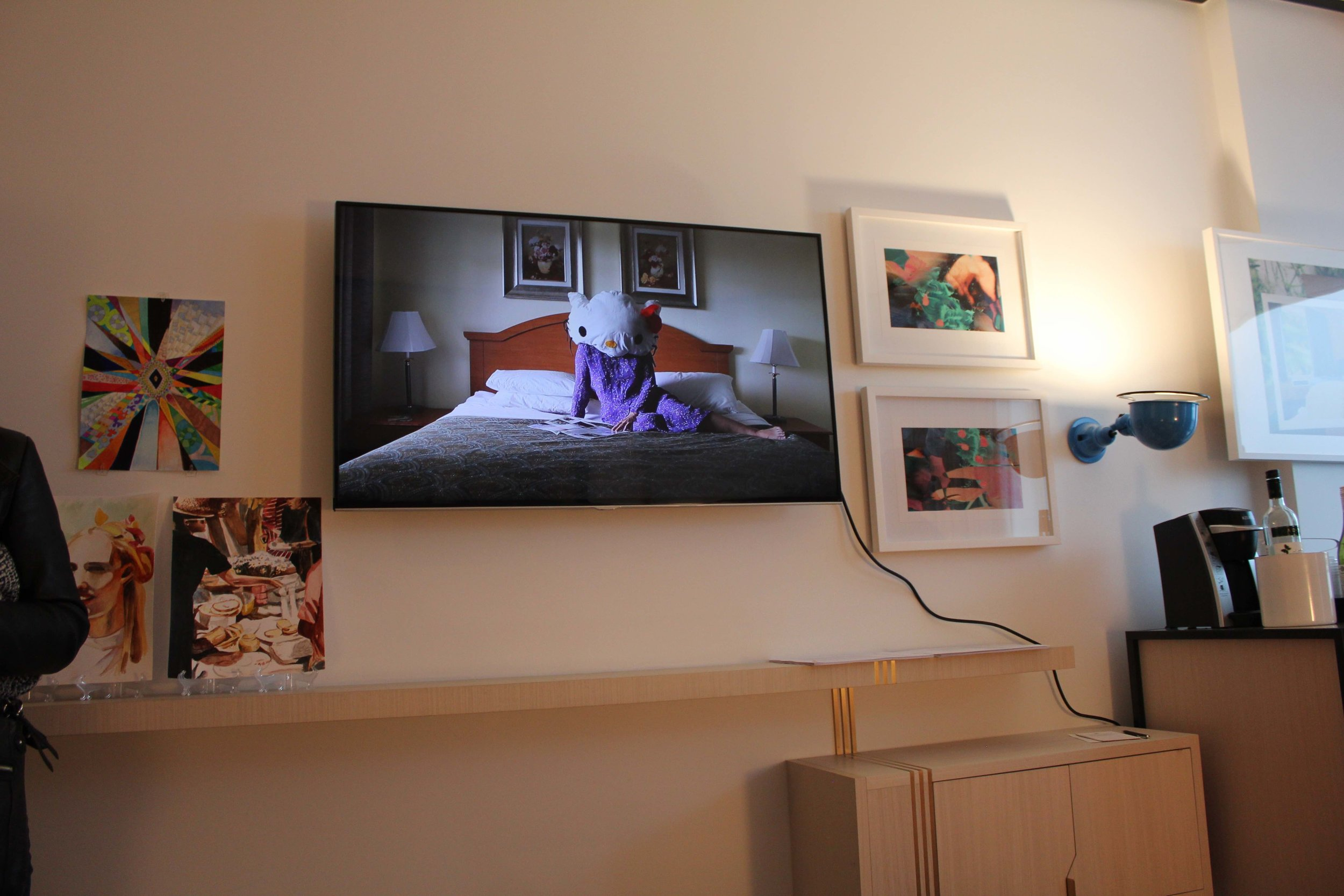 Installation view of two-person show,   Standard Double  :  Hello Reading (2017)  on video screen with work of Alexandra Hammond and in situ works, Brooklyn, NY