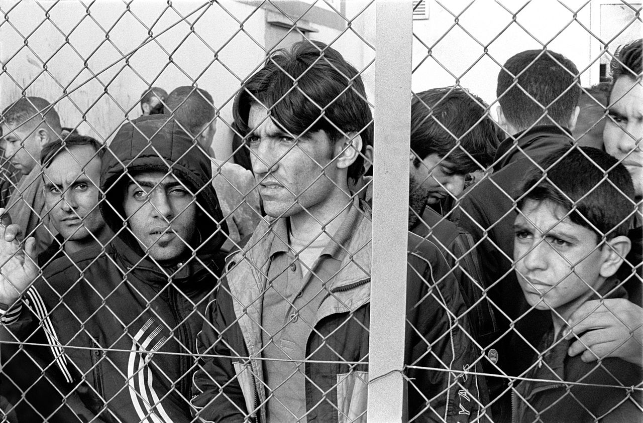 Immigrants in detention courtesy of  Wikimedia .