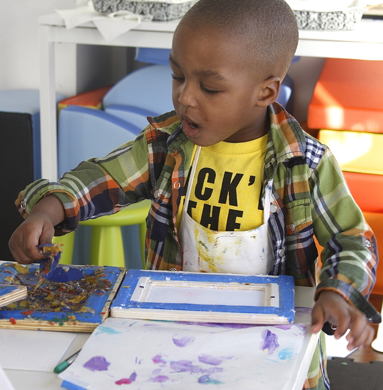 Meet the Artist!     Liam - Age 3 years old, Creating homemade paper from apaper frame.