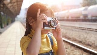 kid with camera art table studio.jpg