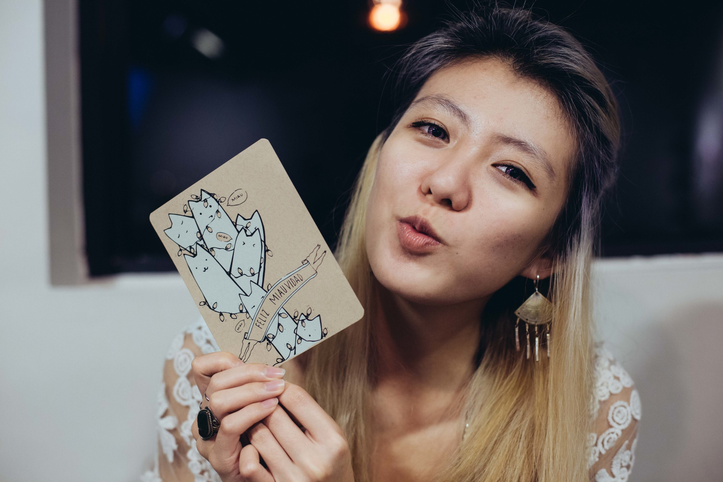 My dearest friend, Che, holding the postcard I made her for Christmas.