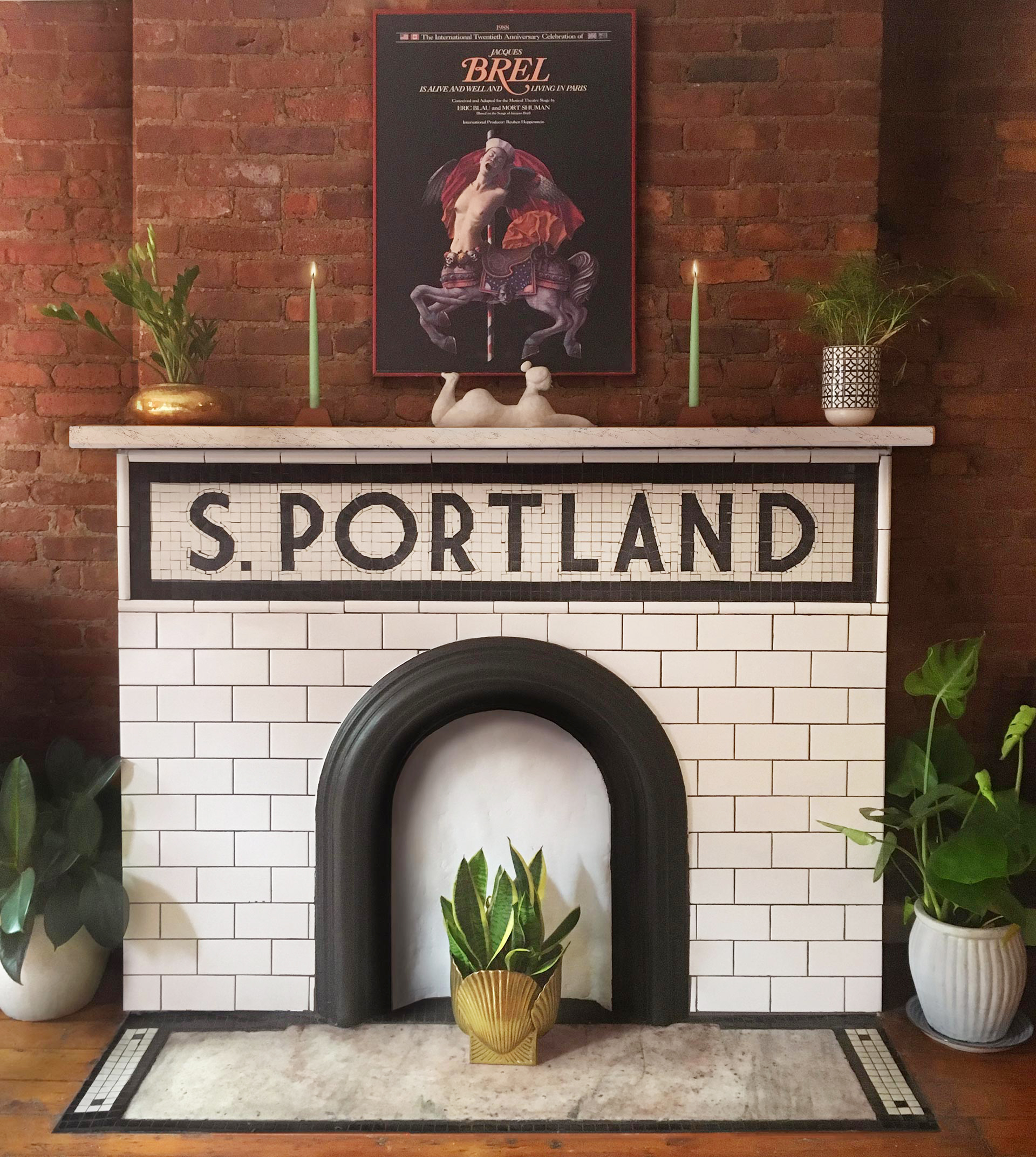 Original  mosaic  and restored fire place and sculpture by Meow House,vintage brass pots and posters.