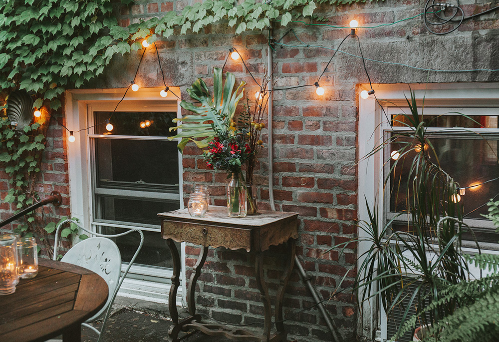 Vintage distress table, strung lights and candles.
