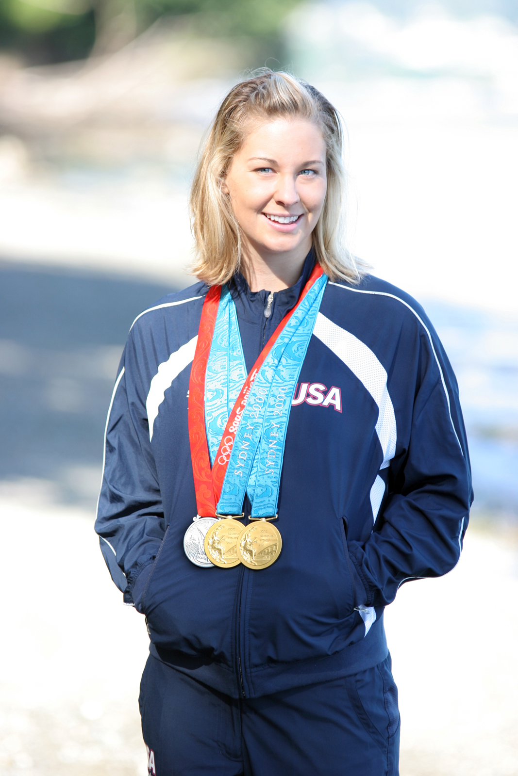 Megan Jendrick w/her Olympic medals.