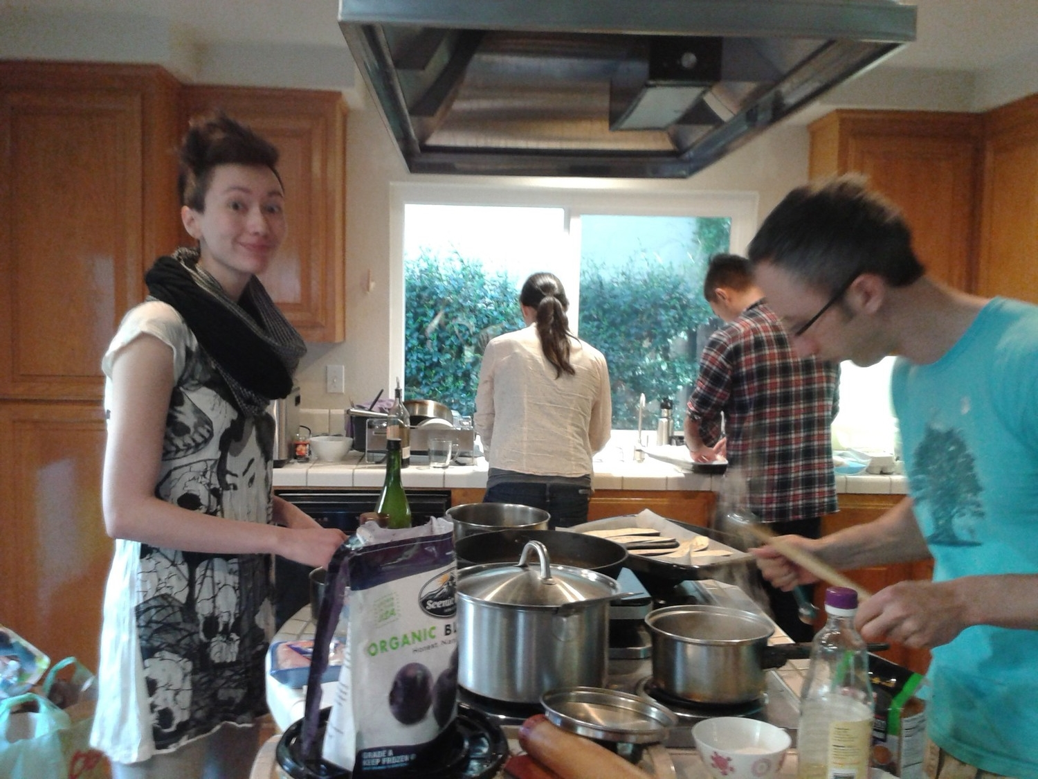 Crowding in the kitchen, making all the foods.