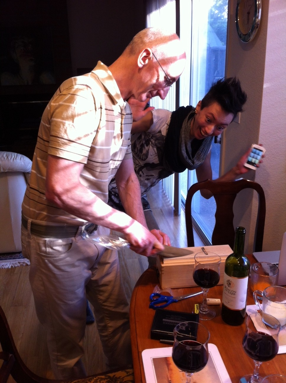 My sister watching in amazement as my dad shaves bonito flakes for dashi.