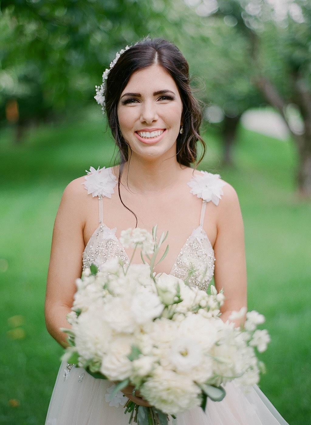 bride smile white bouquet.jpg