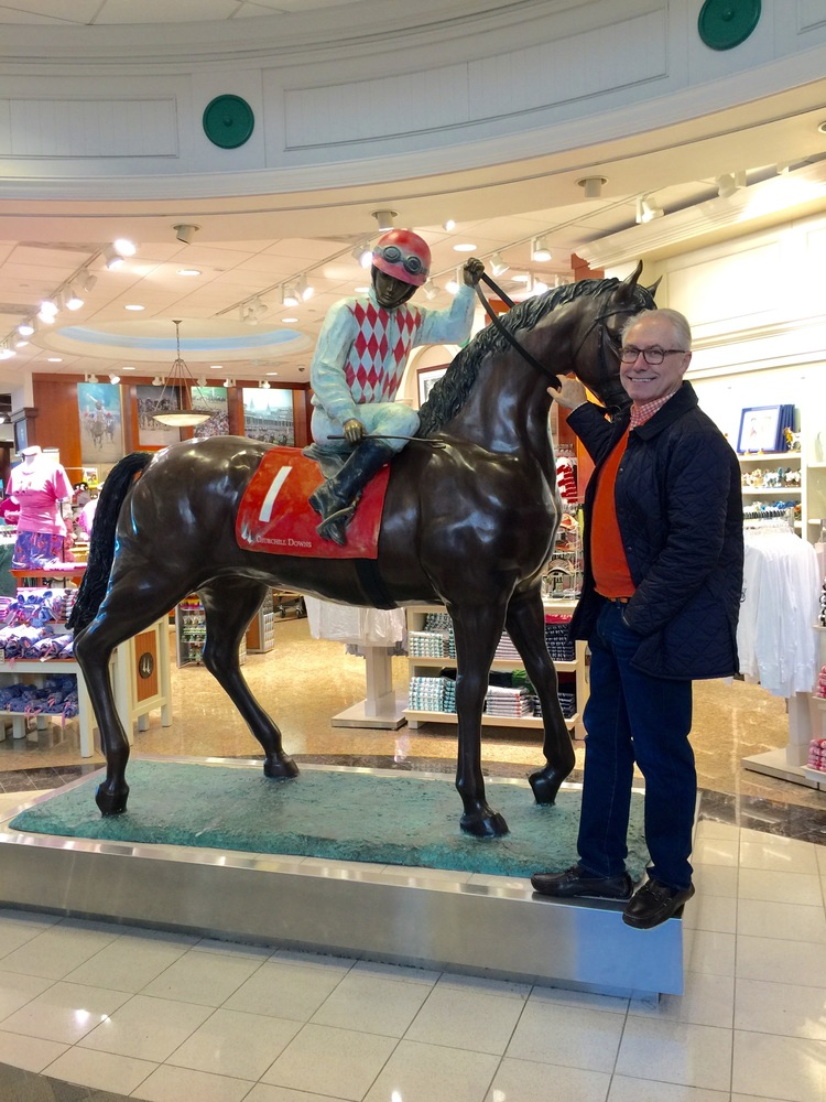 Gary posing  at the Churchill Downs shop at the airport as we were leaving