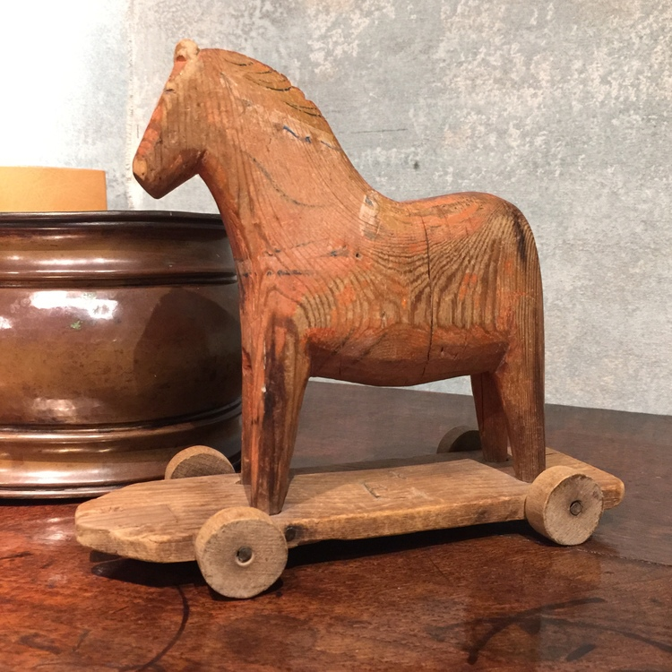 Once a play toy, this carved wooden horse would make a great decorative accessory in a family room or library.