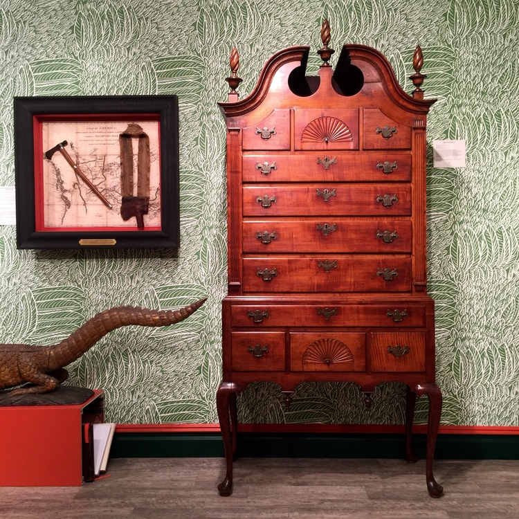 I was immediately drawn to Kelly Kinzle's booth by the patterned green wallpaper and was further interested by the high chest of drawers and the framed sheath and sling.  The carved alligator prevented the scheme from getting too serious!