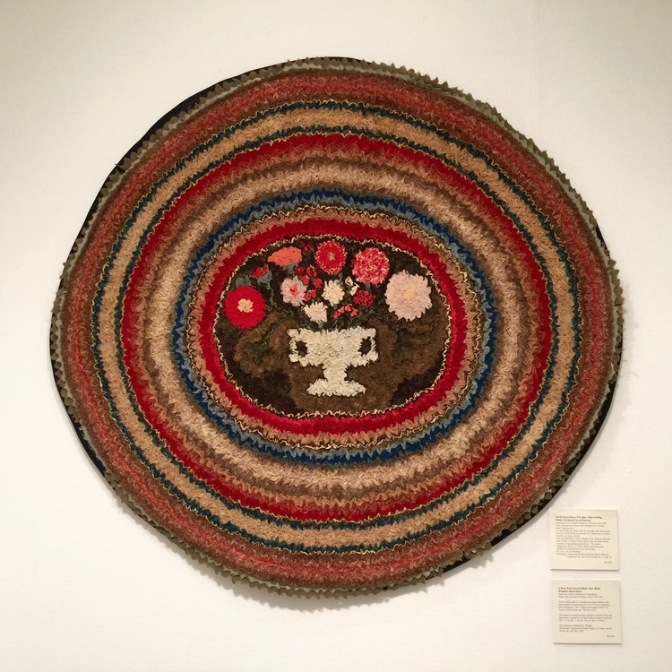 An extraordinary circular shirred rug with a stylized urn of flowers, circa 1840, was displayed by Frank & Barbara Pollack American Antiques & Art.