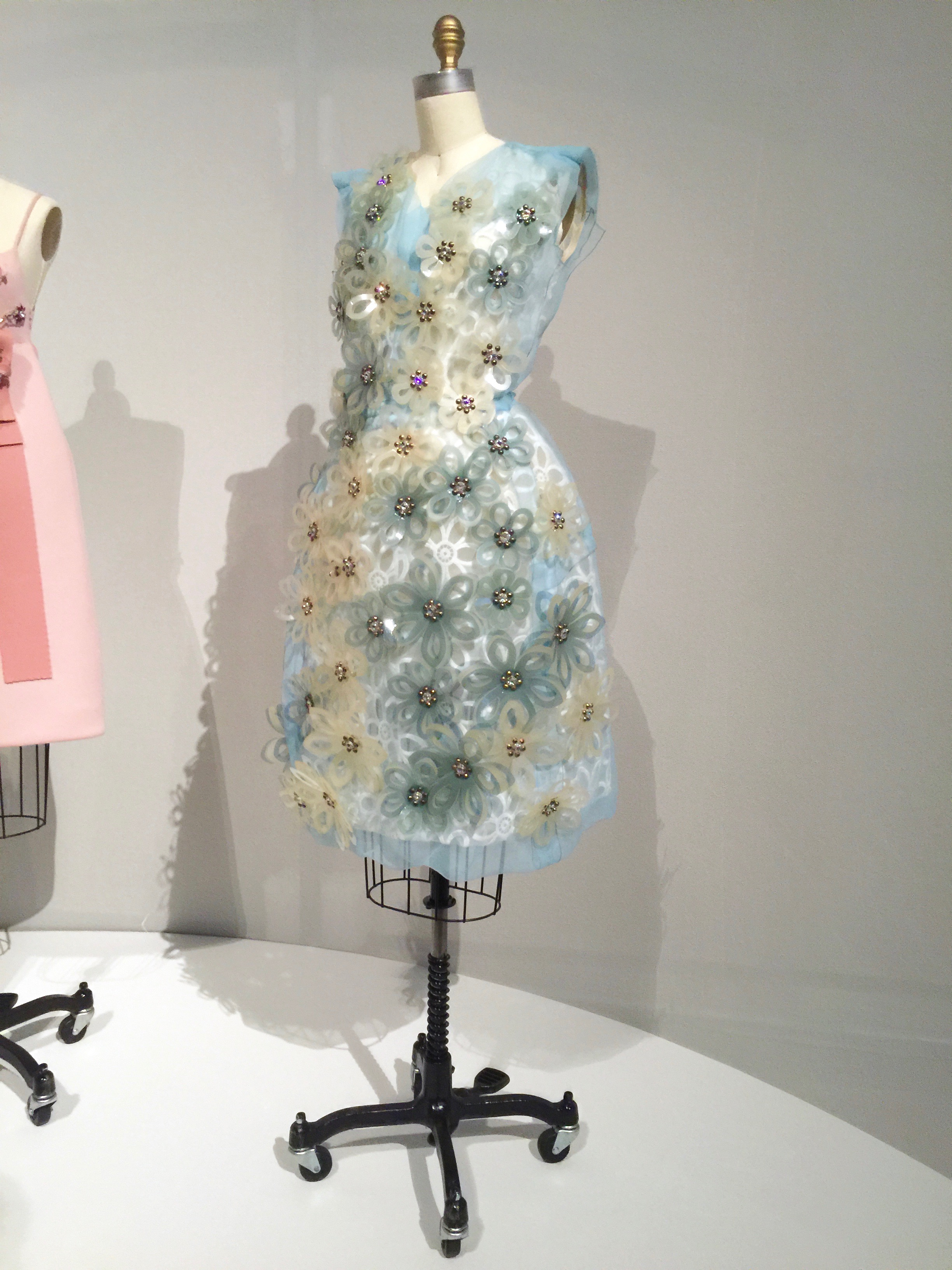 LOUIS VUITTON, Marc Jacobs  DRESS, Spring/Summer 2012, prêt-à-porter  Dress:  machine-sewn blue silk-polyester crinkle organza, hand-embroidered with laser-cut white and blue plastic flowers, grommeted with clear crystals and silver metal studs, hand-finished; Slip:  machine-sewn white polyester organdy with machine-made broderie anglaise flowers