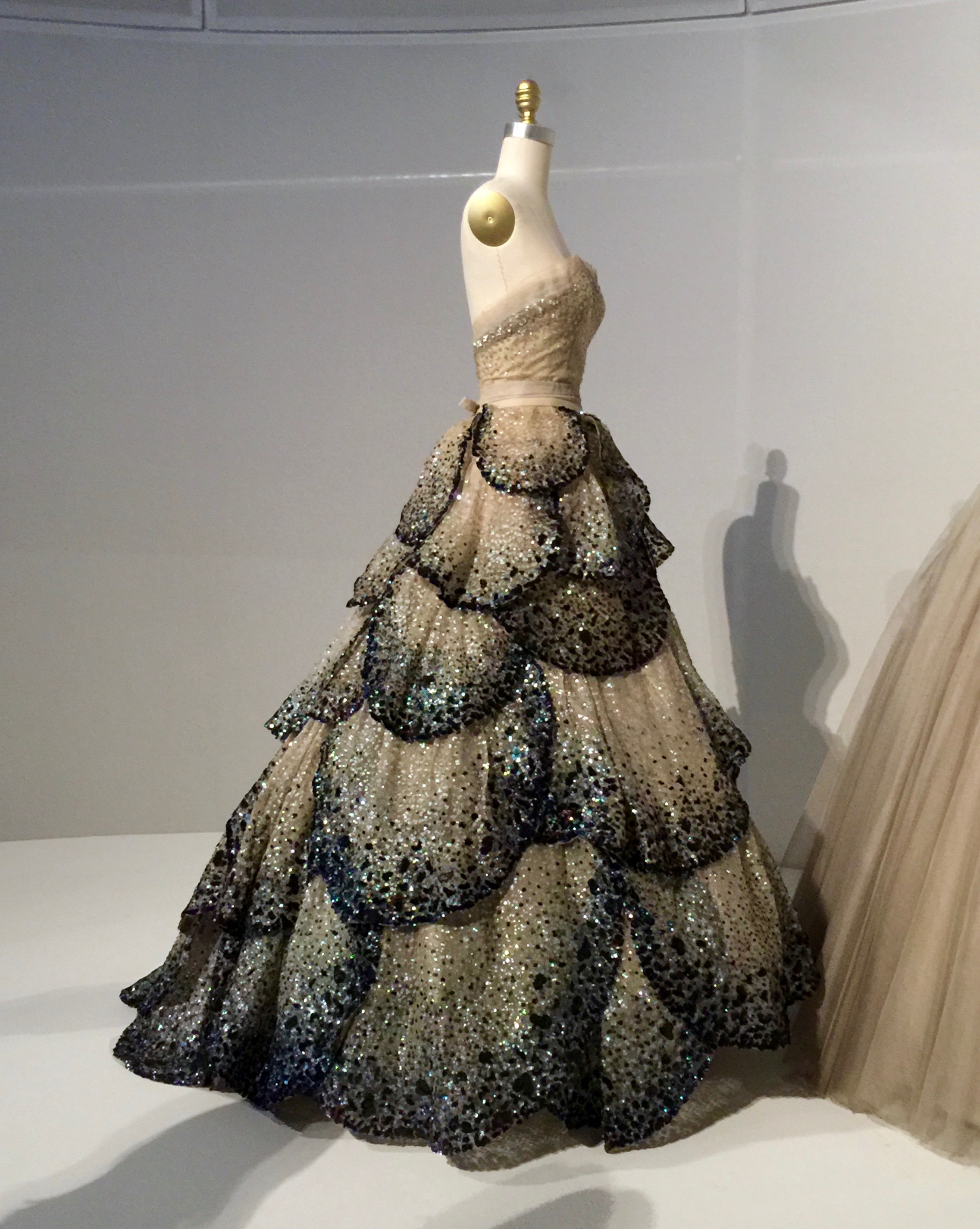 "HOUSE OF DIOR, Christian Dior ""JUNON"" DRESS, Autumn/Winter 1949-50, haute couture  Machine-sewn, hand-finished pale green silk faille and taffeta foundation, hand-sewn pale blue silk tulle embroidered with opalescent sequins, hand-appliqué of forty-five hand-cut pale blue silk tulle and horsehair petals, hand-embroidered with opalescent, blue, green, and orange gelatin sequins."