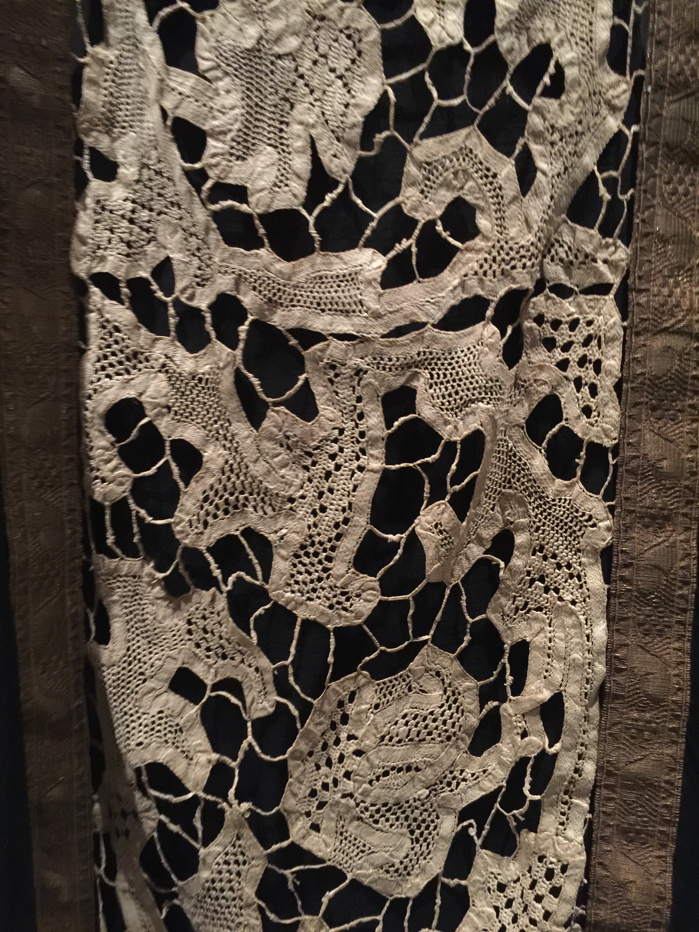 ATTRIBUTED TO CALLOT SOEURS EVENING DRESS, Ca. 1920, haute couture  Detail of hand-sewn inserts of antique ivory bobbin-made tape lace with needle-made fillings