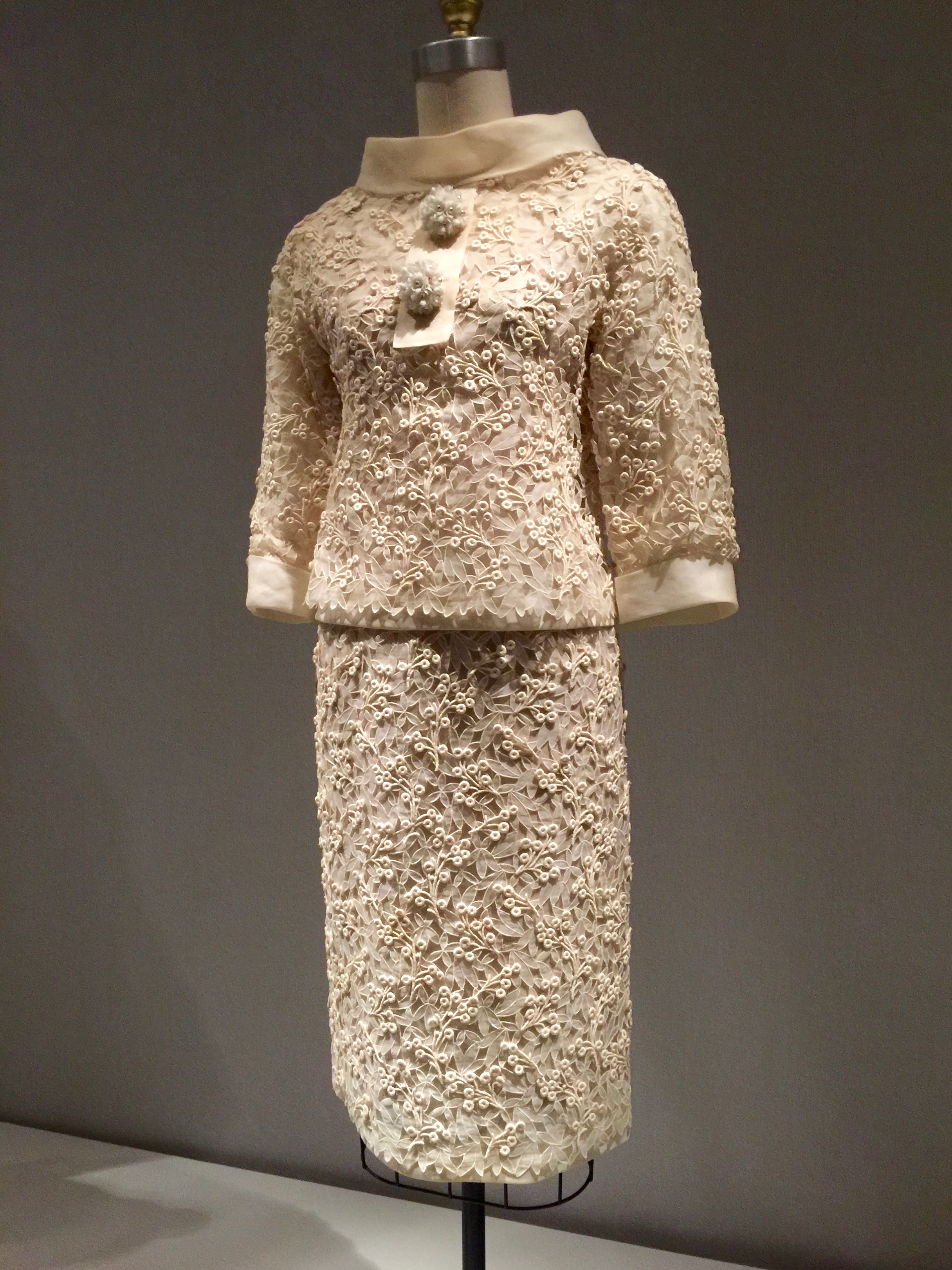 HOUSE OF DIOR, Christian Dior SUIT, Spring/Summer 1963, haute couture  Machine-sewn white cotton organdy with overlay of machine-embroidered cutwork hand-stitched with machine-embroidered guipure lace; hand-finished