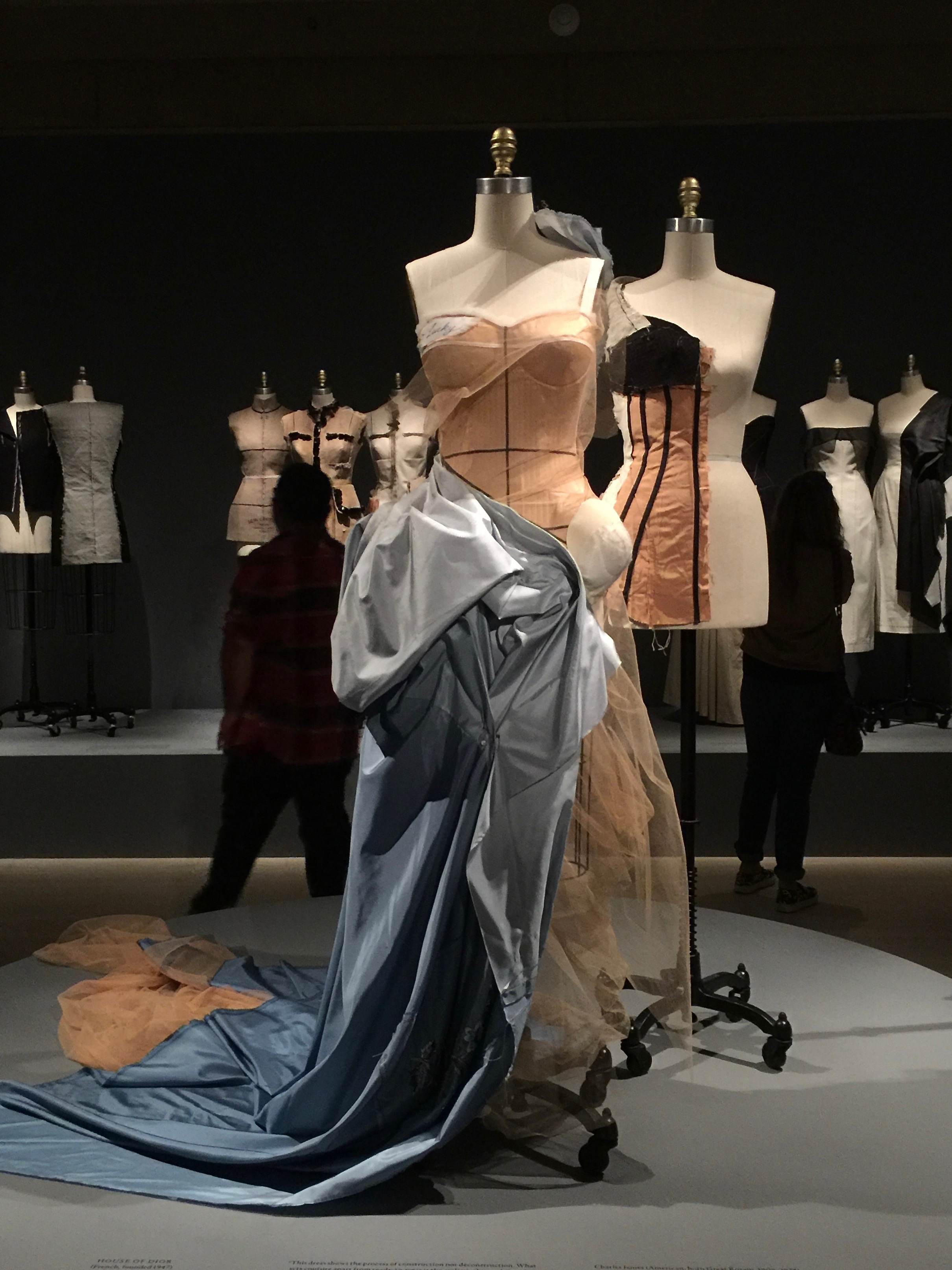 HOUSE OF DIOR, John Galliano ENSEMBLE, Autumn/Winter 2005-6, haute couture  Machine-sewn nude silk satin, hand-stitched white polyester batting, hand-draped and hand-basted nude silk net and hand-pieced-dyed blue silk taffeta, hand-embroidered with clear glass beads, opalescent rhinestones, blue and ivory chenille, and silver metal cord and strips