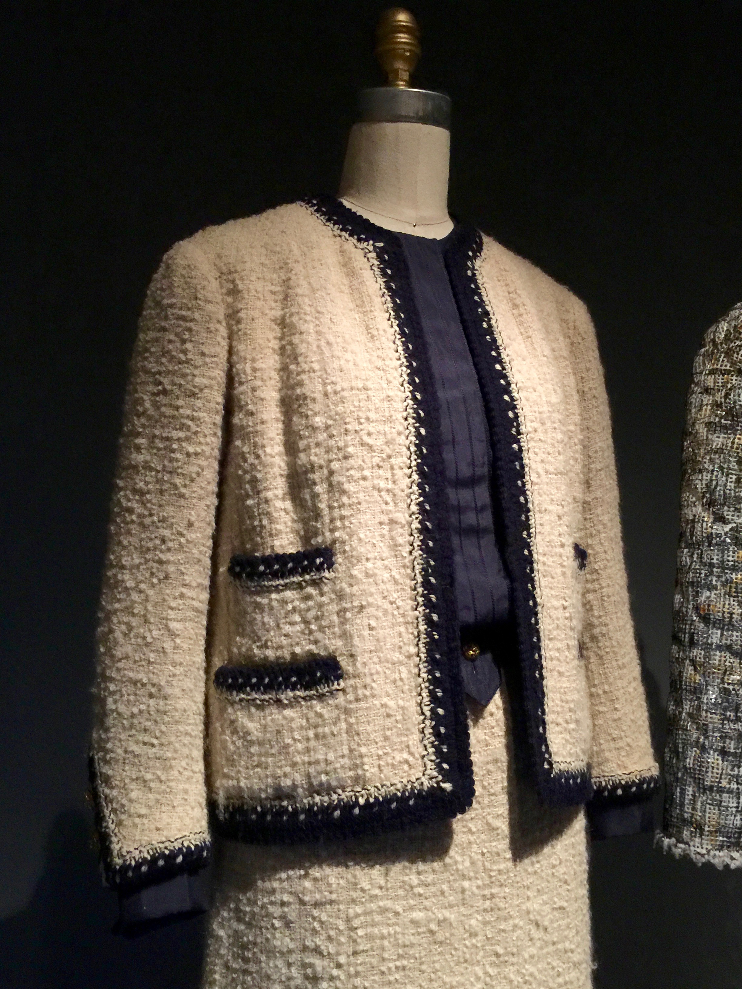 Machine-sewn ivory wool bouclé tweed, hand-applied navy and ivory wool knit trim hand-braided with interlocking chain stitch