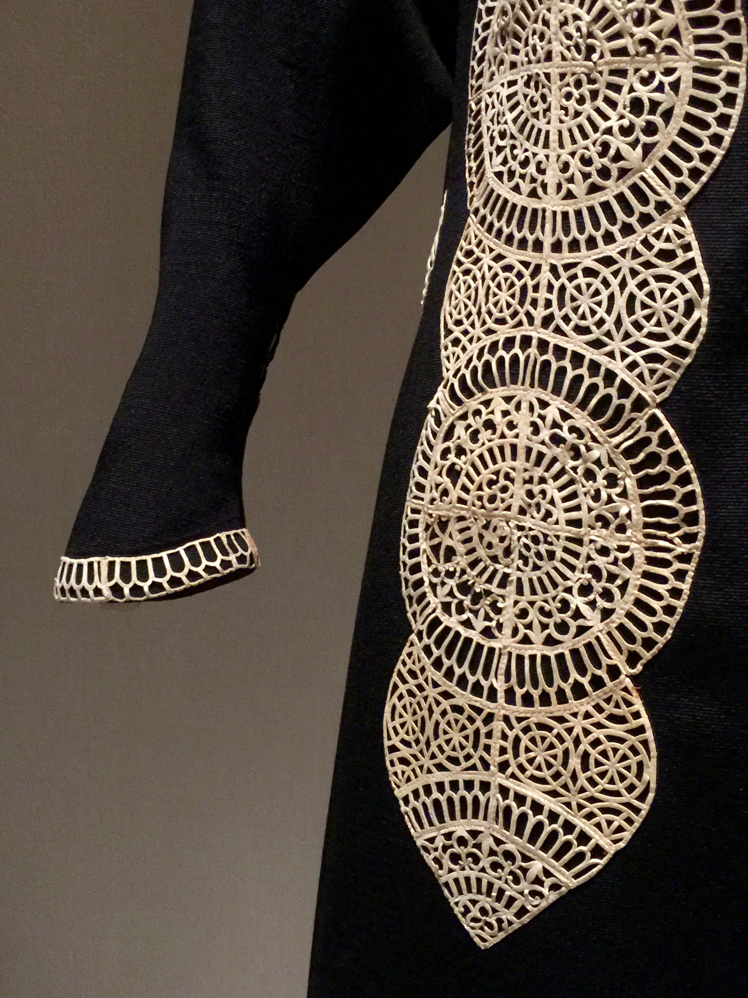 Detail of the white kidskin cutwork