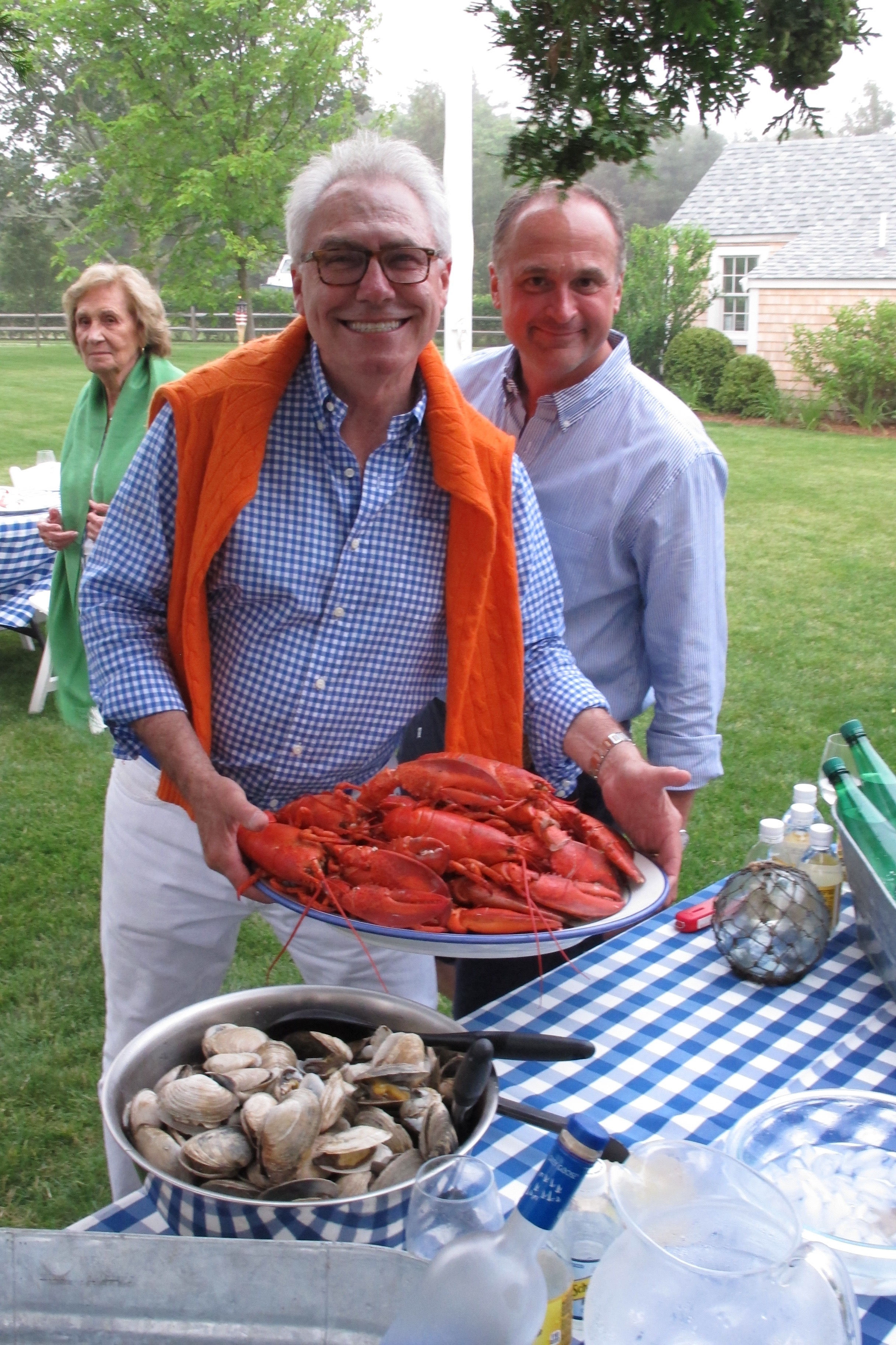 Gary holding a platter of freshly cooked lobsters.
