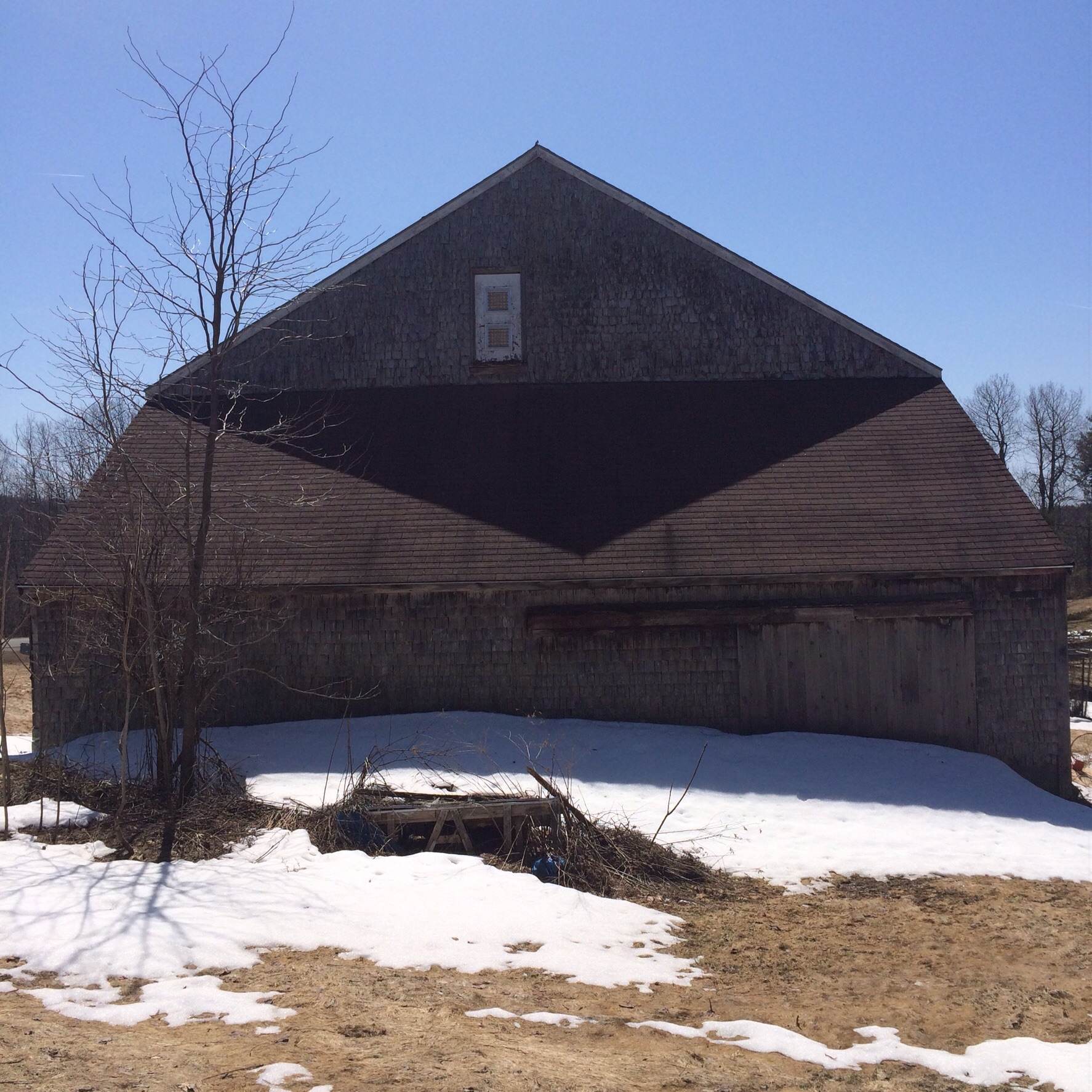 Angular shadows on the back of the barn.