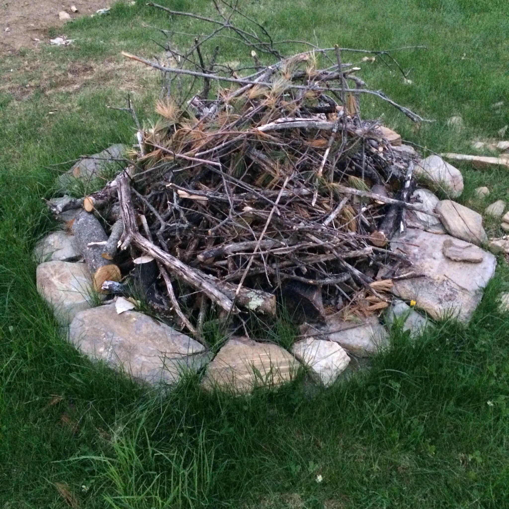 The campfire is ready for the first fire of the season.