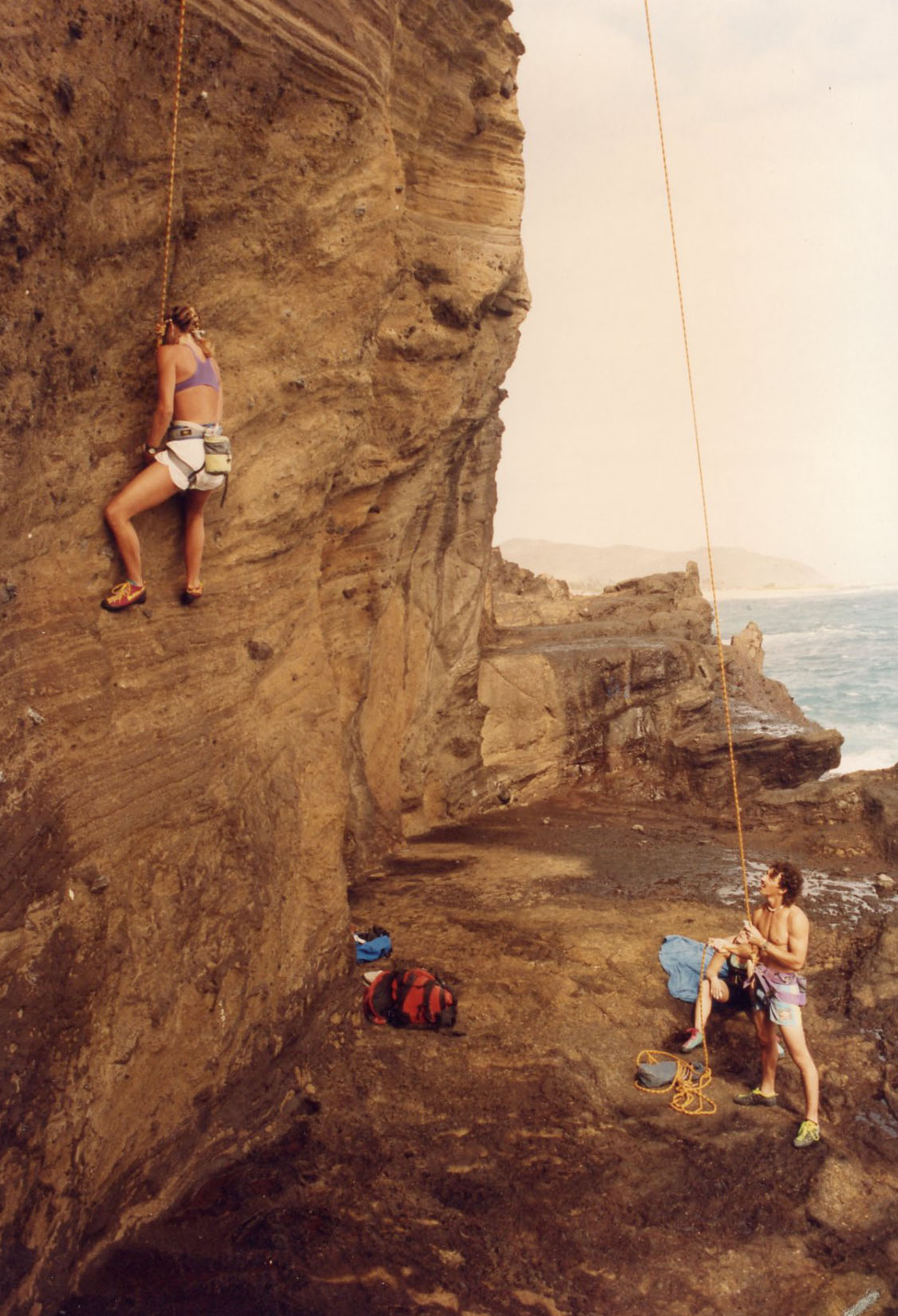 """The Blowhole, 1991. """"The Blowhole site was great fun until a wave doused everyone except the climber on the wall."""""""