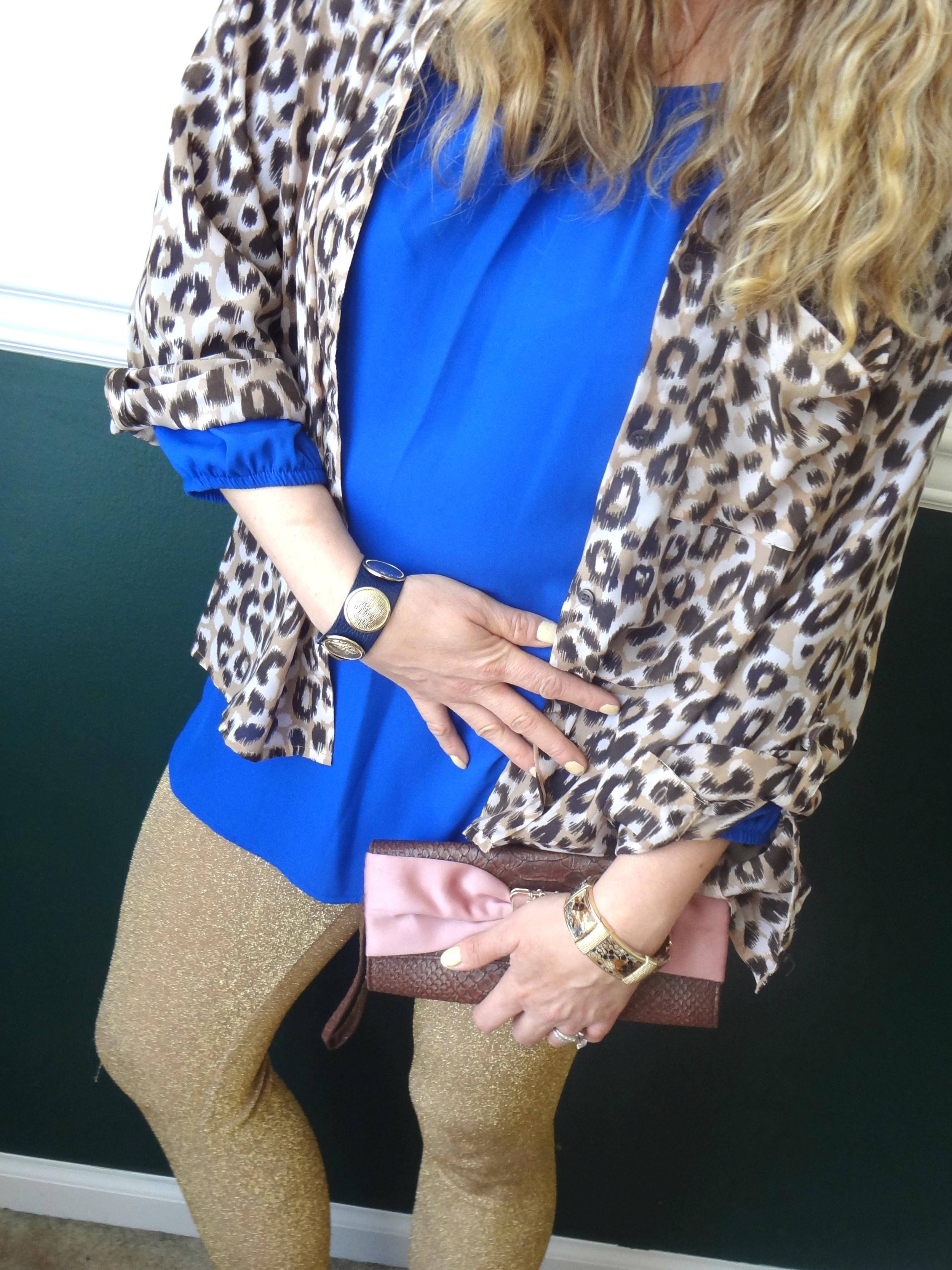 Leopard Print Blouse: H&M (t his one would work too ), Cobalt Blue Tunic: Mod Cloth ( this one would look great over the blouse ) , Leggins: H&M ( i love these too ), Jewelery: Balenciaga ( similar here ) Palm Beach, Clutch: Liz Clairbone (old), Shoes: Mossimo ( these would work well too)