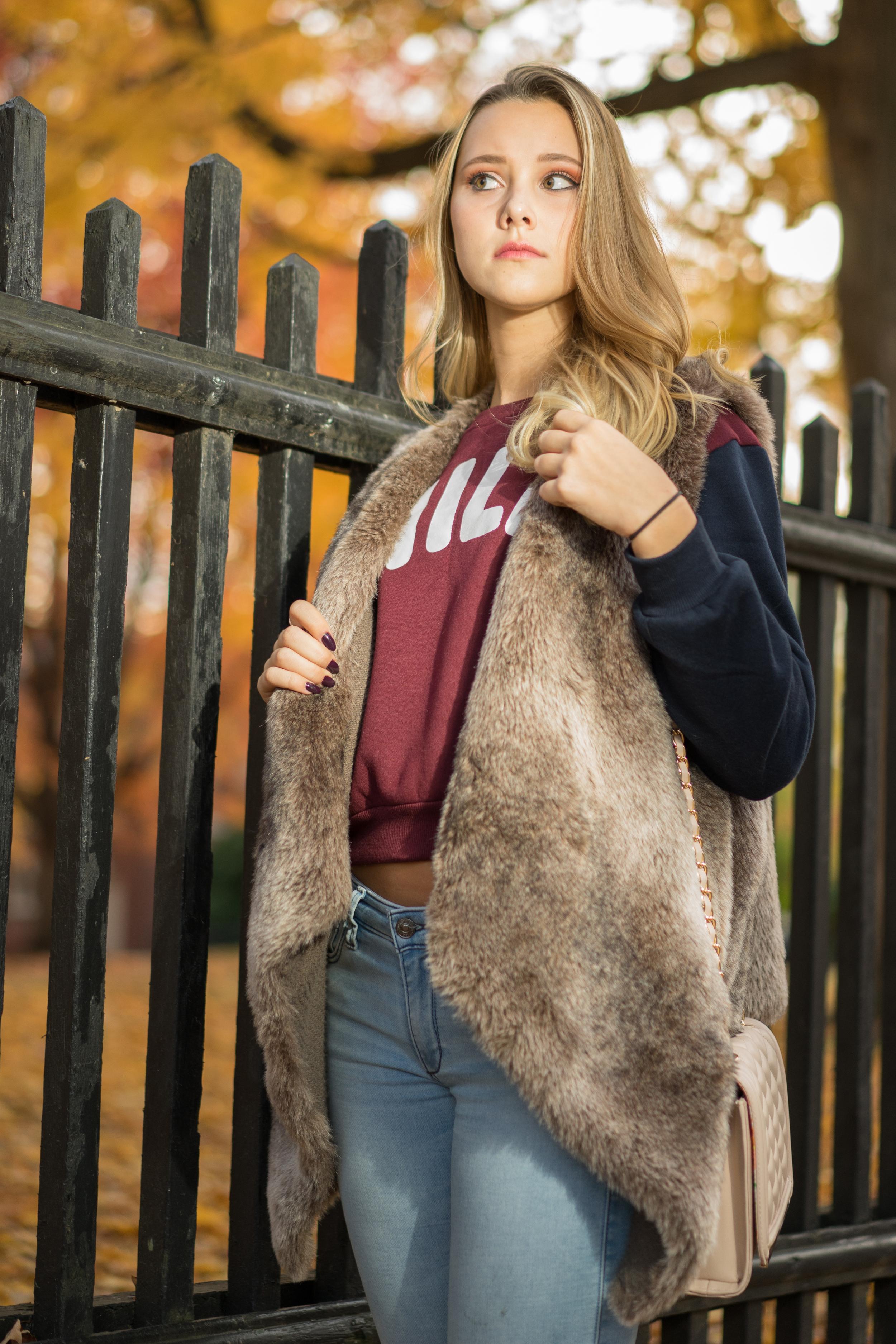 Angelica is wearing: Vest: Zara, Sweatshirt: ROMWE, Bag: Aldo, Jeans: Forever 21, Boots: Charlotte Russe