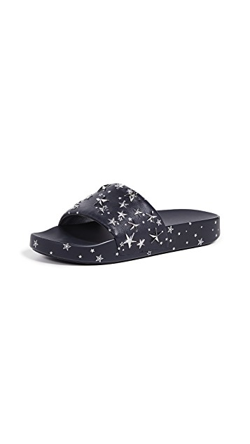 Tory Burch     Star Slides   Keep your feet with style! Yes, this season we can pair slides with thick socks!