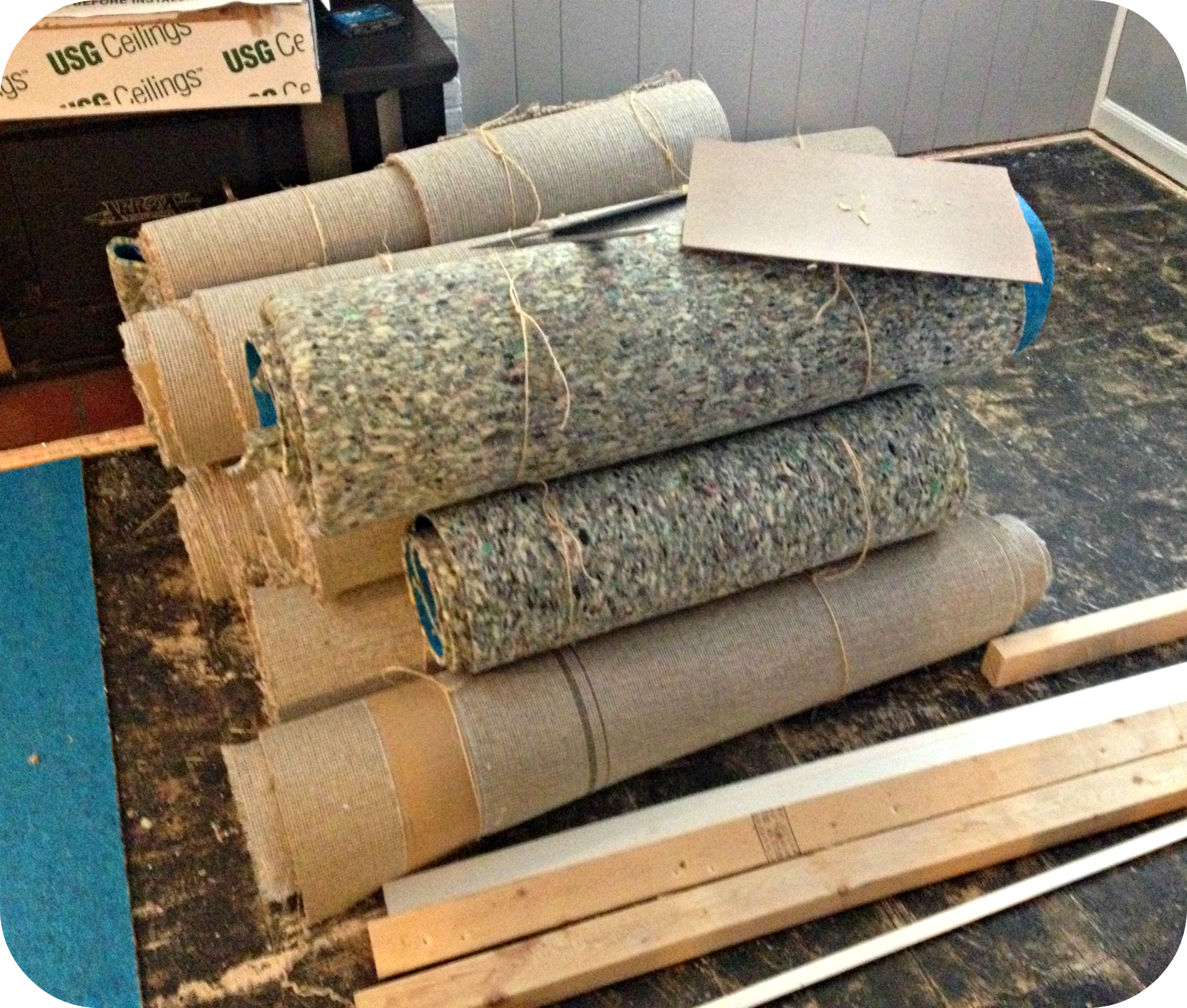 A great example ofhow to roll up old carpet.