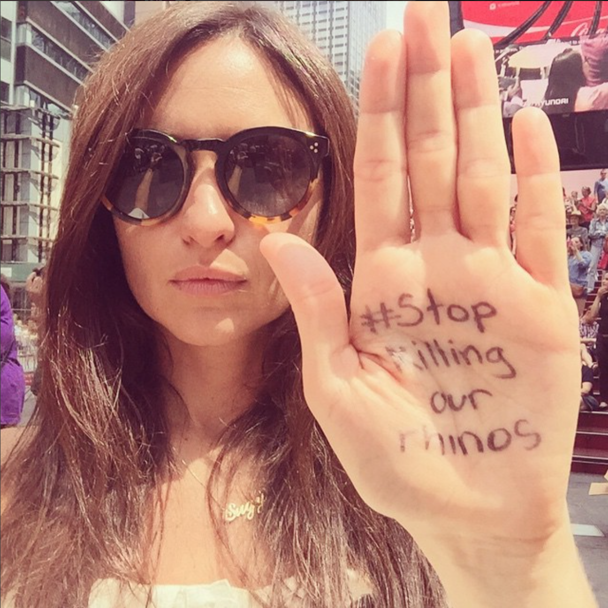 Morgan at the #STOPKILLINGOURRHINOS rally in Times Square, NYC