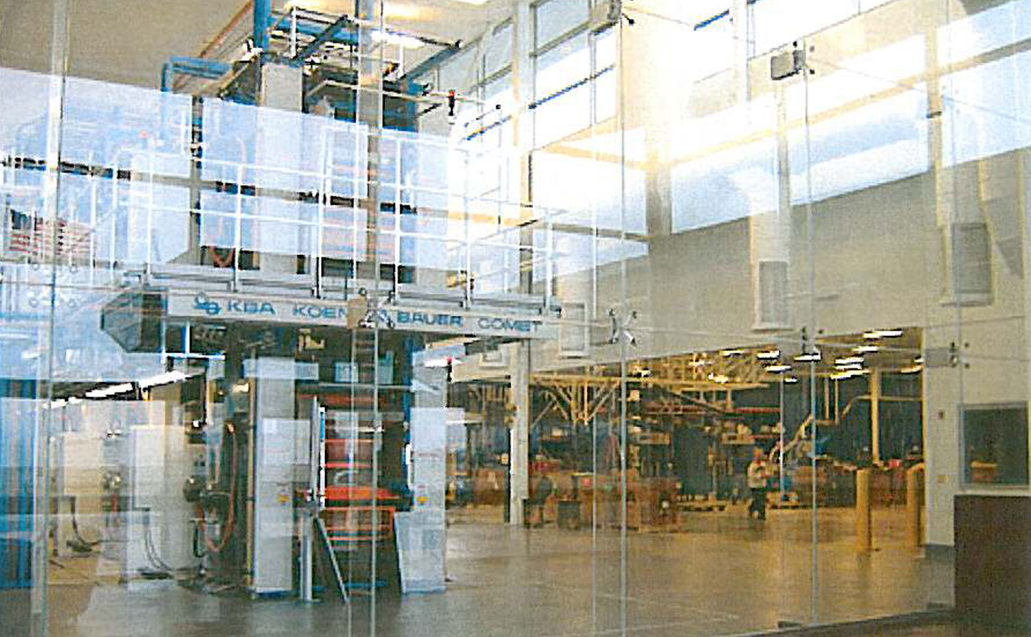press-behind-glass-wall.jpg