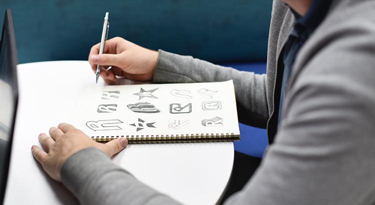 man drawing logos