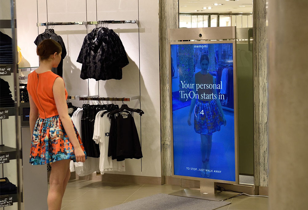 Neiman Marcus' Memory Mirror lets customers record, review and share photos of clothes tried on in-store with friends via the NM customer app.