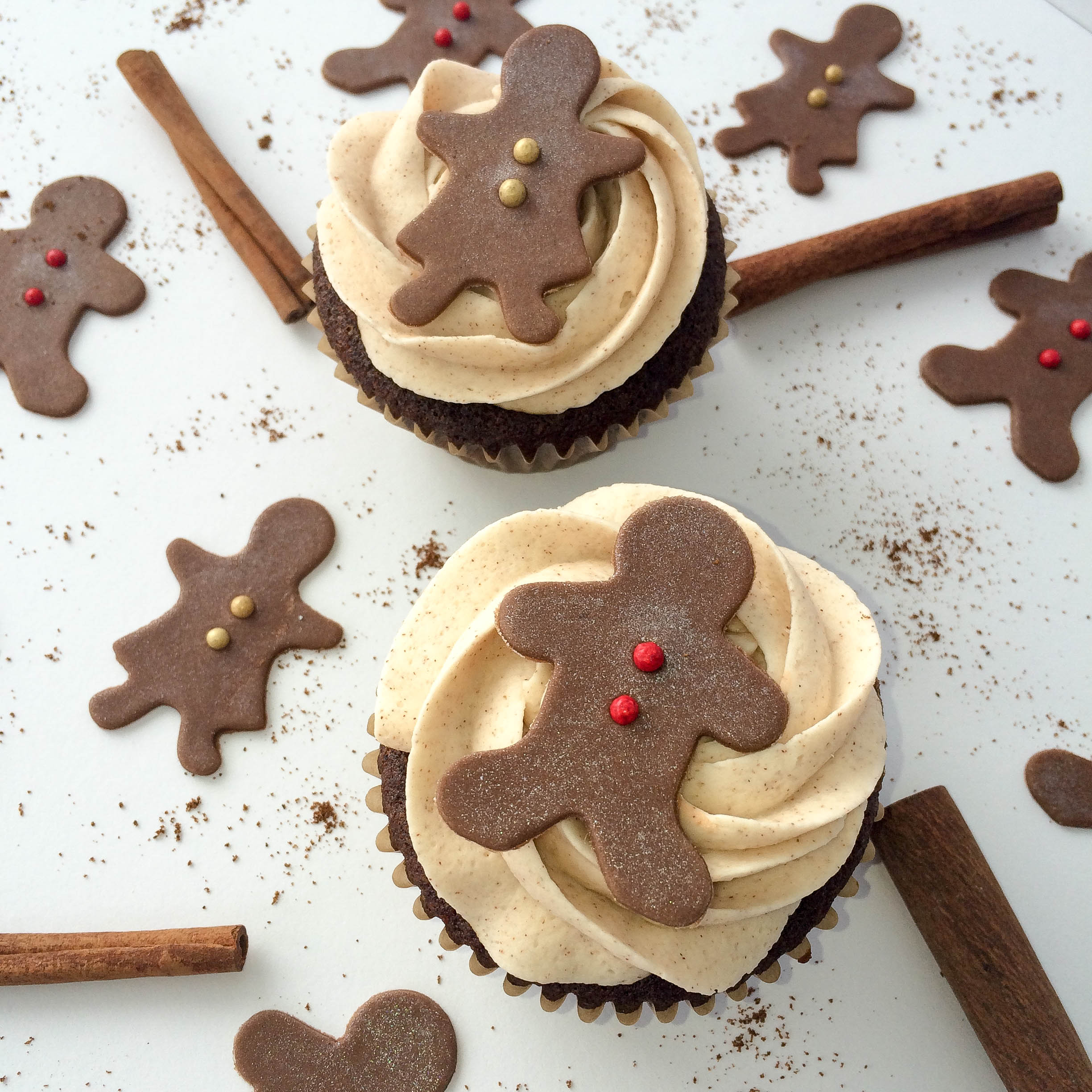 Gingerbread cupcakes with chocolate fondant boy and girl