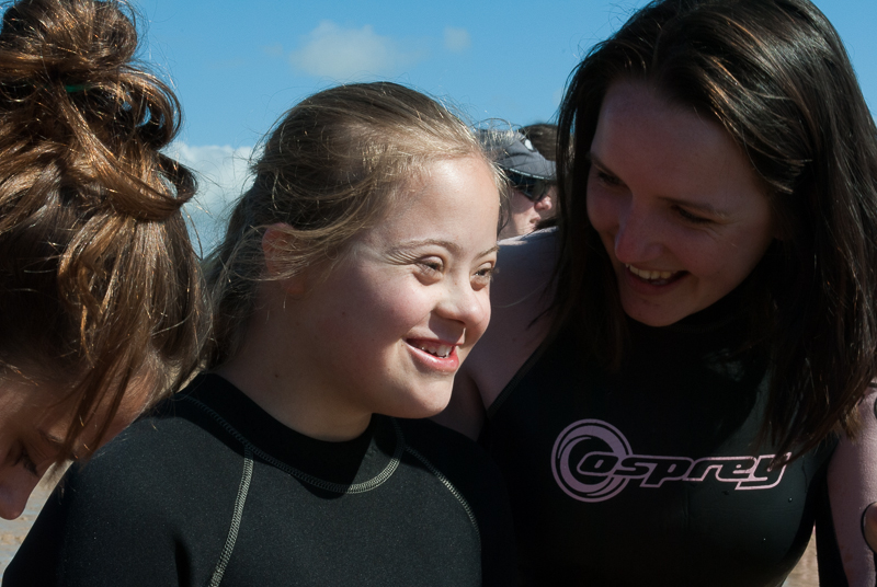 Young surfing girl with Down Syndrome
