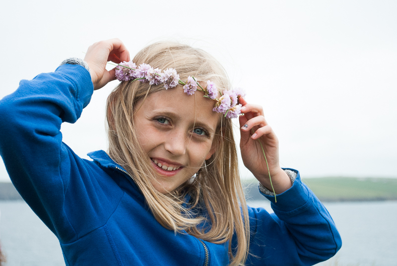 Pretty crown of coastal flowers on young girl