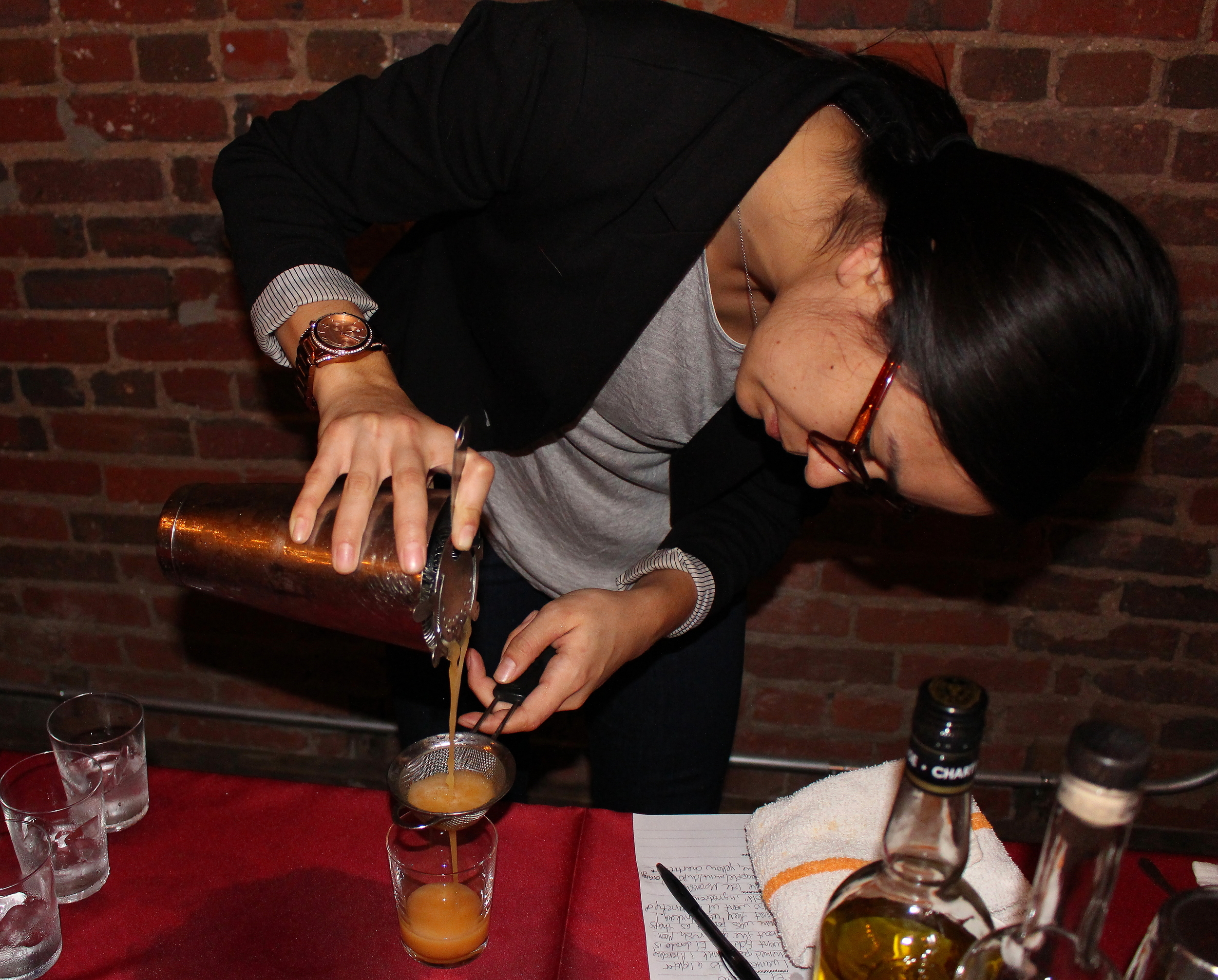 "Caroline Blundell of Ripple pours her Poe-inspired cocktail, ""The Gold Rush"""