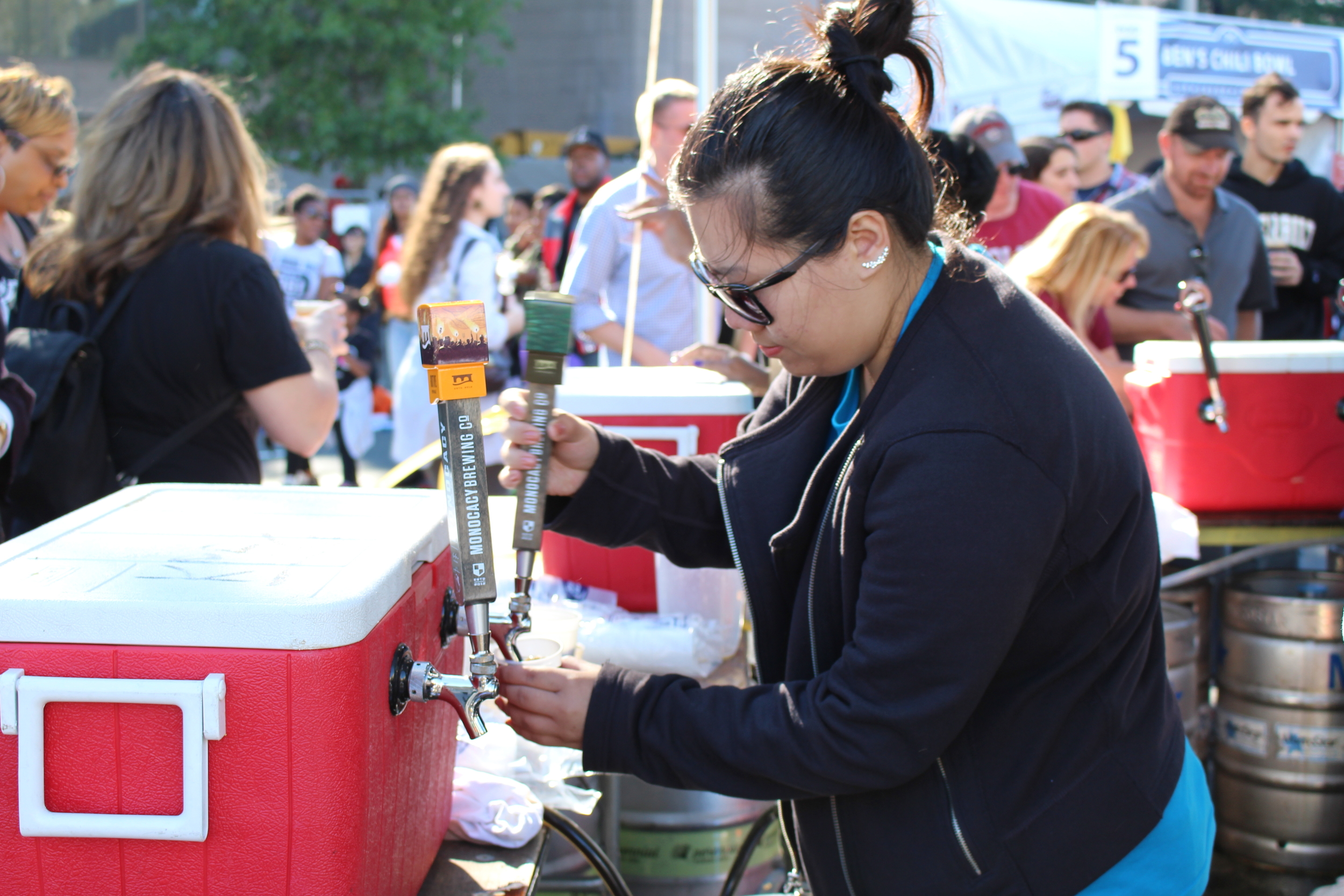 pouring samples at one of the many beer tents