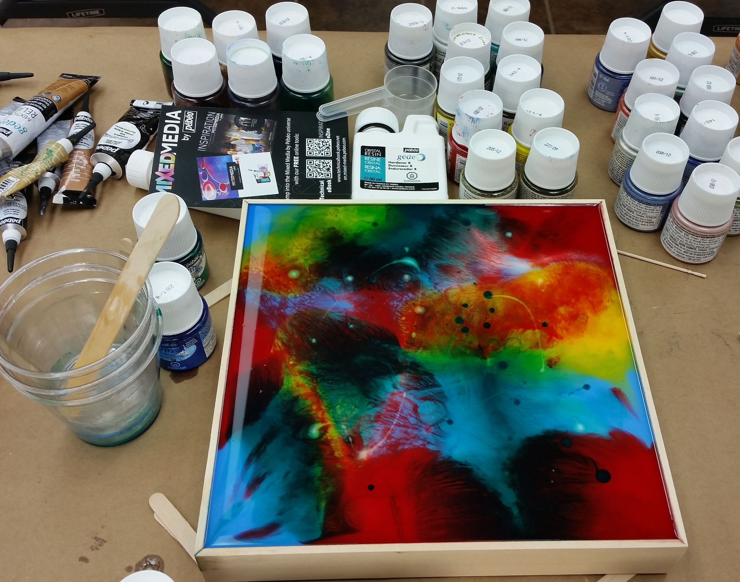 I gave a demonstration in how to use Vitrail transparent paint to tint Pebeo Crystal Resin, then pour in a liquid art panel for easy painting.