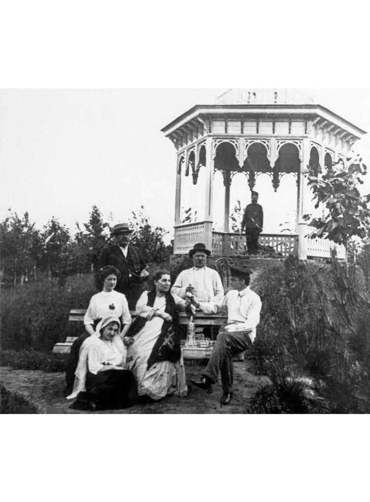 1.7 ┆   At grandfather's estate.   Standing on left: maternal grandfather Zakhar Fyodorovich Shcherbak. Seated: Aunt Ira and maternal grandmother Yevdokiya Georgievna. At Aunt Ira's feet: mother Taisia Shcherbak.