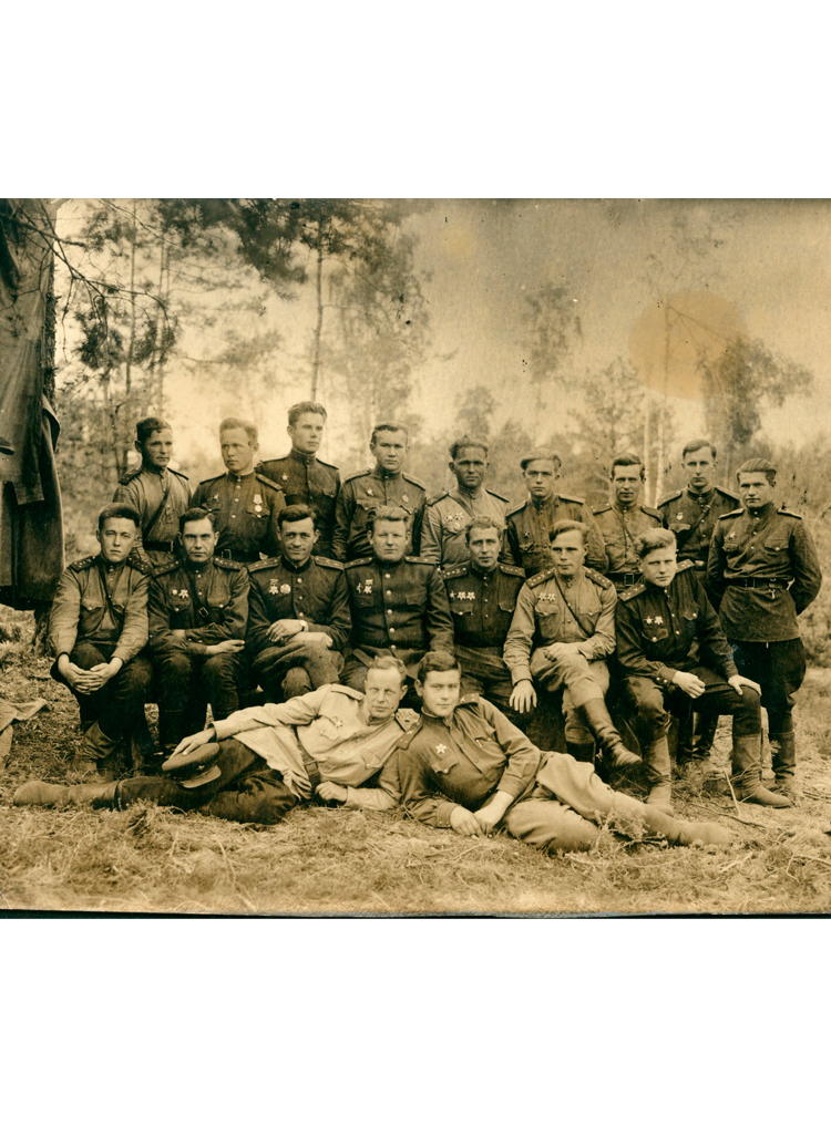 2.5 ┆   Artillery reconnaissance officers. Captain Solzhenitsyn is seated in middle row, far  left.   Autumn 1944