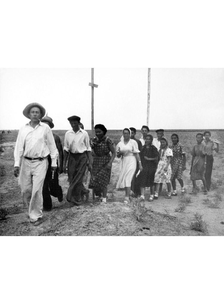 3.4 ┆   Teacher Aleksandr Solzhenitsyn leads pupils into the steppe to study geodesy.   Kok-Terek, 1955