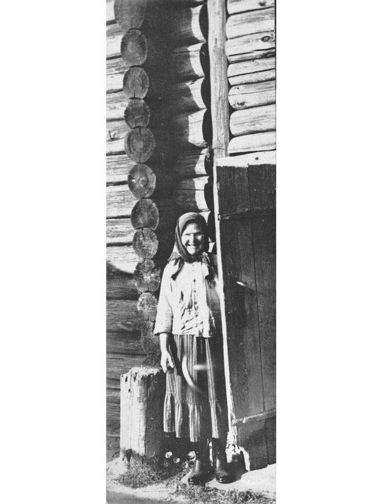 """4.2 ┆   Matryona Vasilievna Zakharova (of """"Matryona's Home"""") by her hut.   1956"""