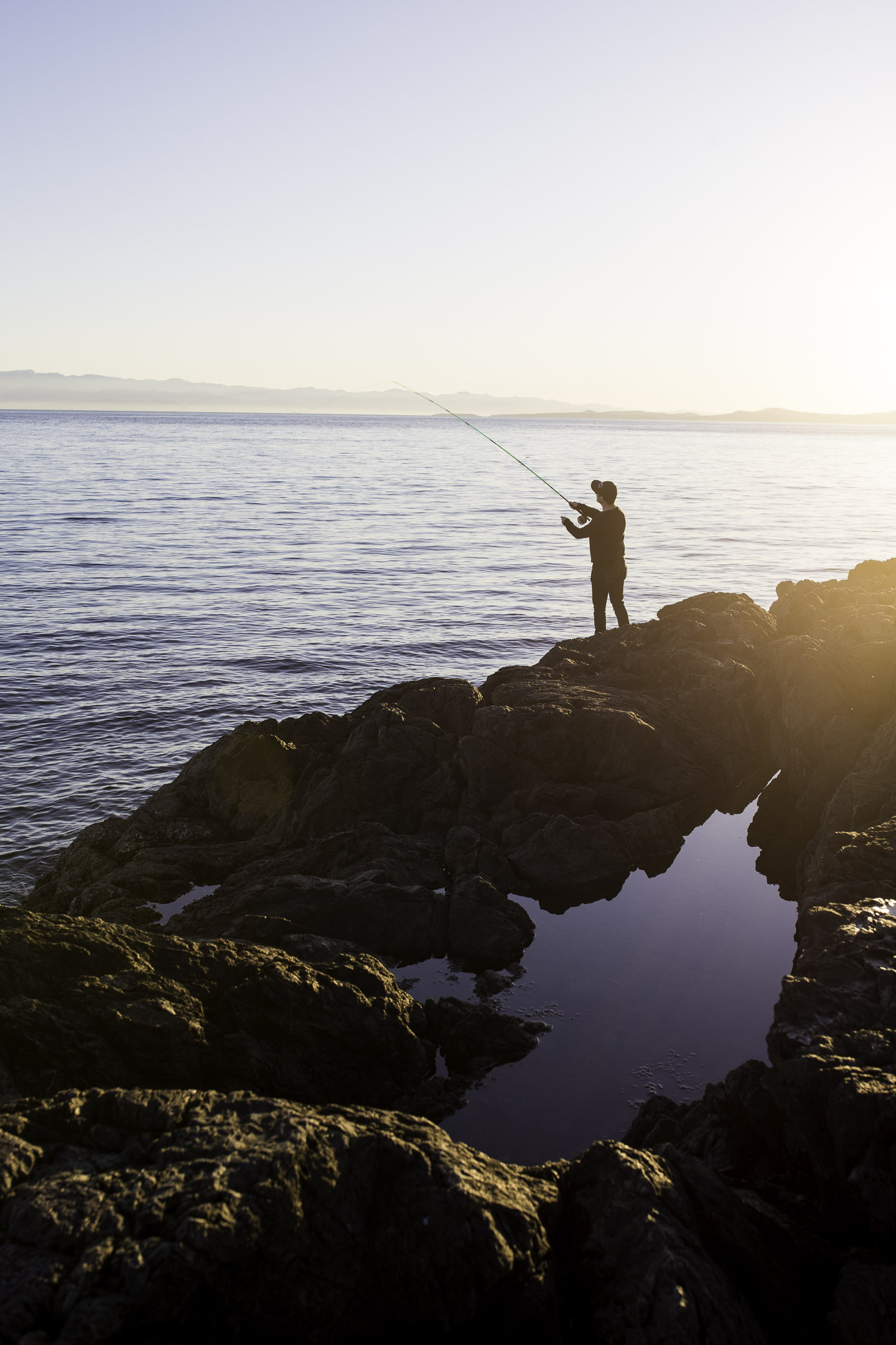 A fisherman at dusk on the Pacific Ocean. Shot in Victoria, BC, Canada