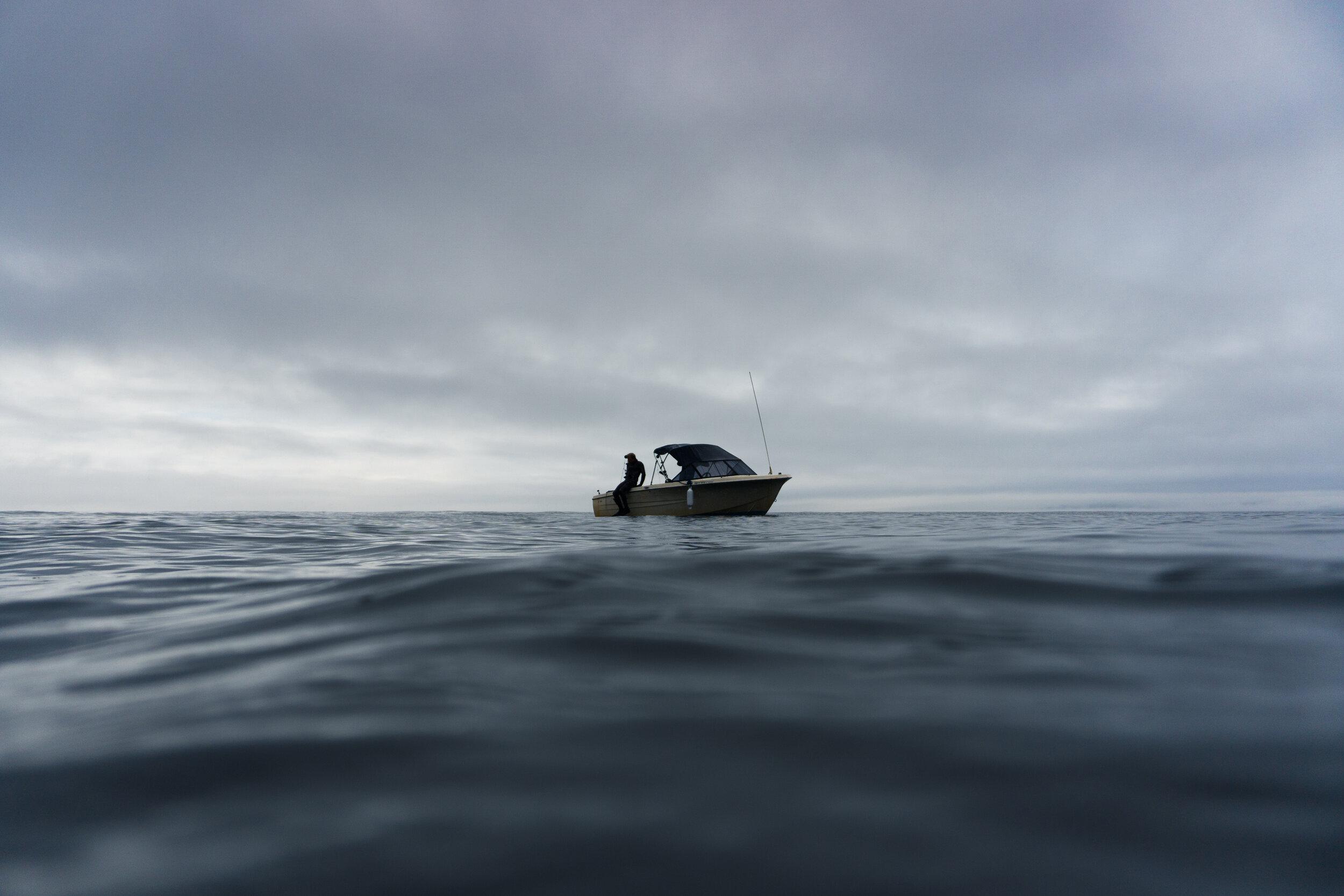 Spear Fisherman on Boat