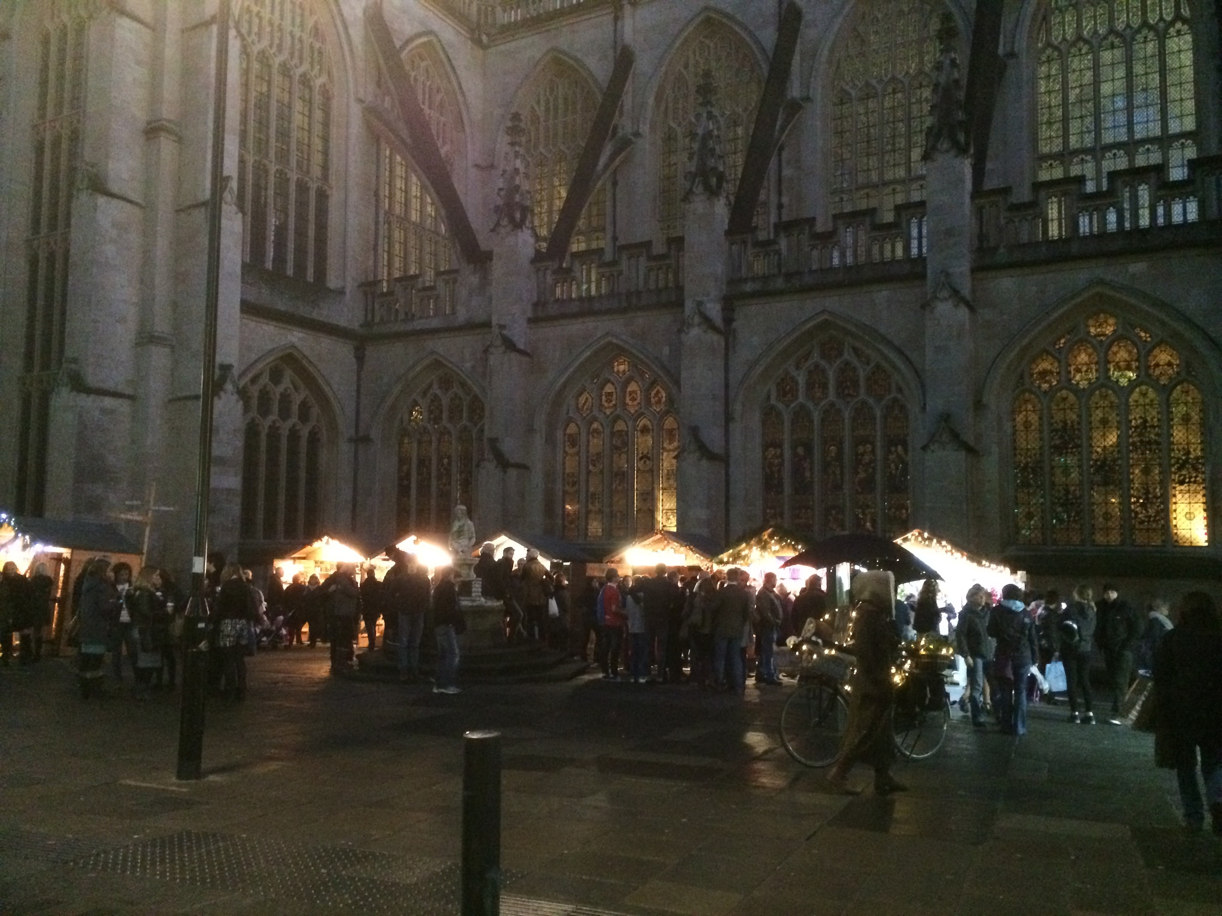 A rare shot of the Christmas market attwilight in theshadow of the abbey. It was so pretty seeing all the stalls lit up.