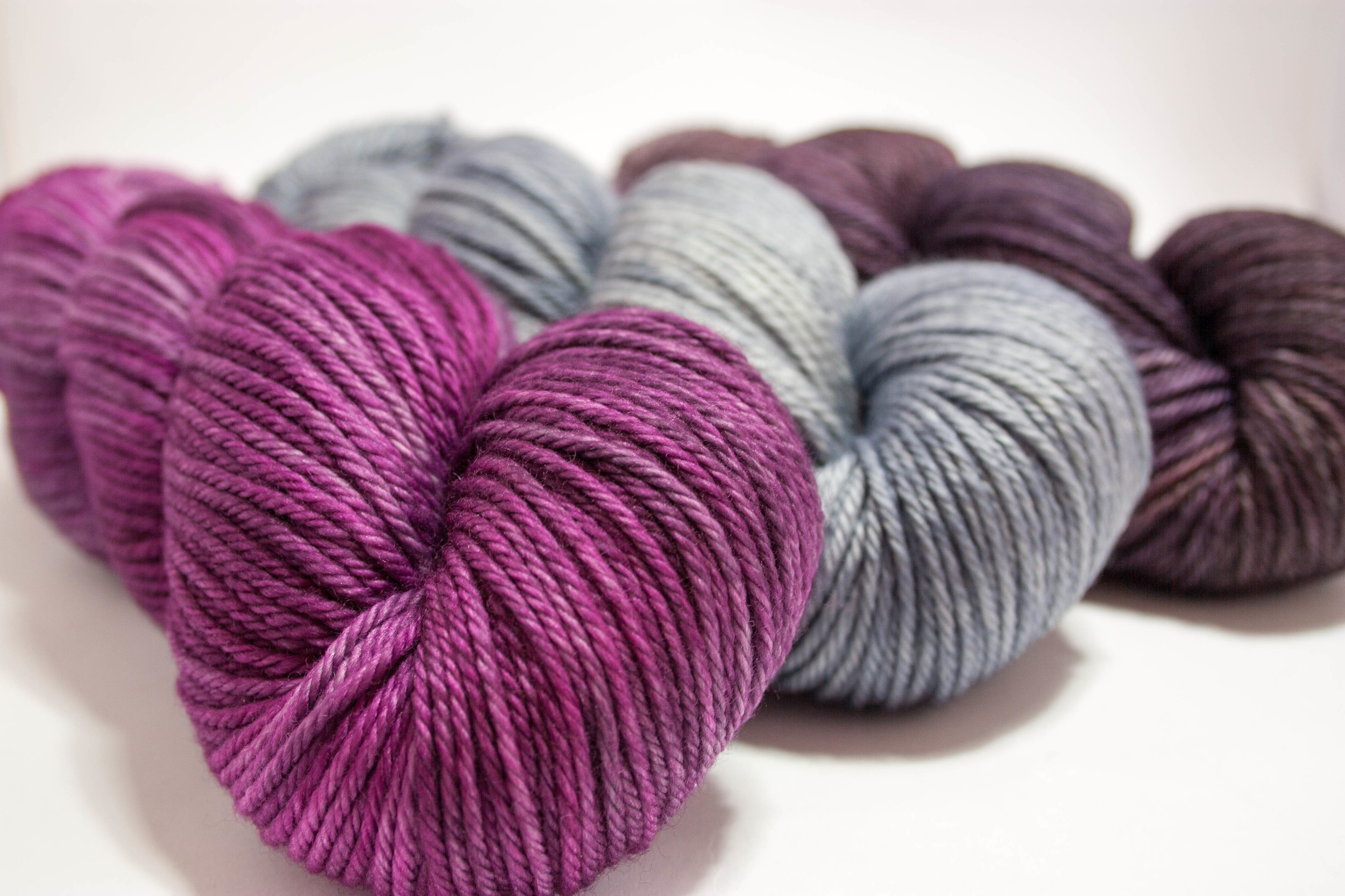 Some of the tempting hand dyed yarns available from Tangled Yarn