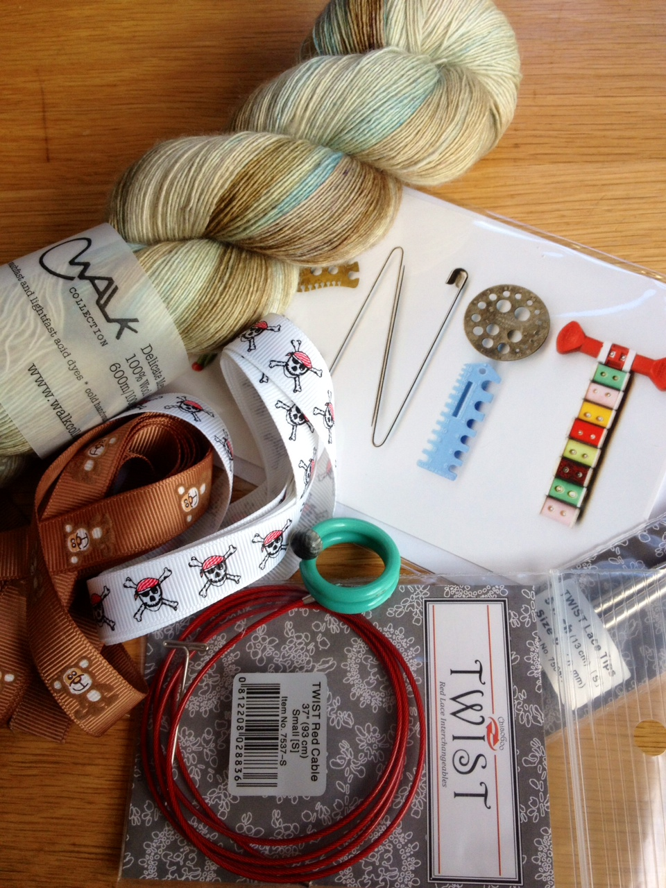 Rachel's purchases: ribbons from Brighton Sewing Centre, ring and card from Yellow Bear Wares, lovely Walk Collection yarn and ChiaoGoo tips/cable from YAK.